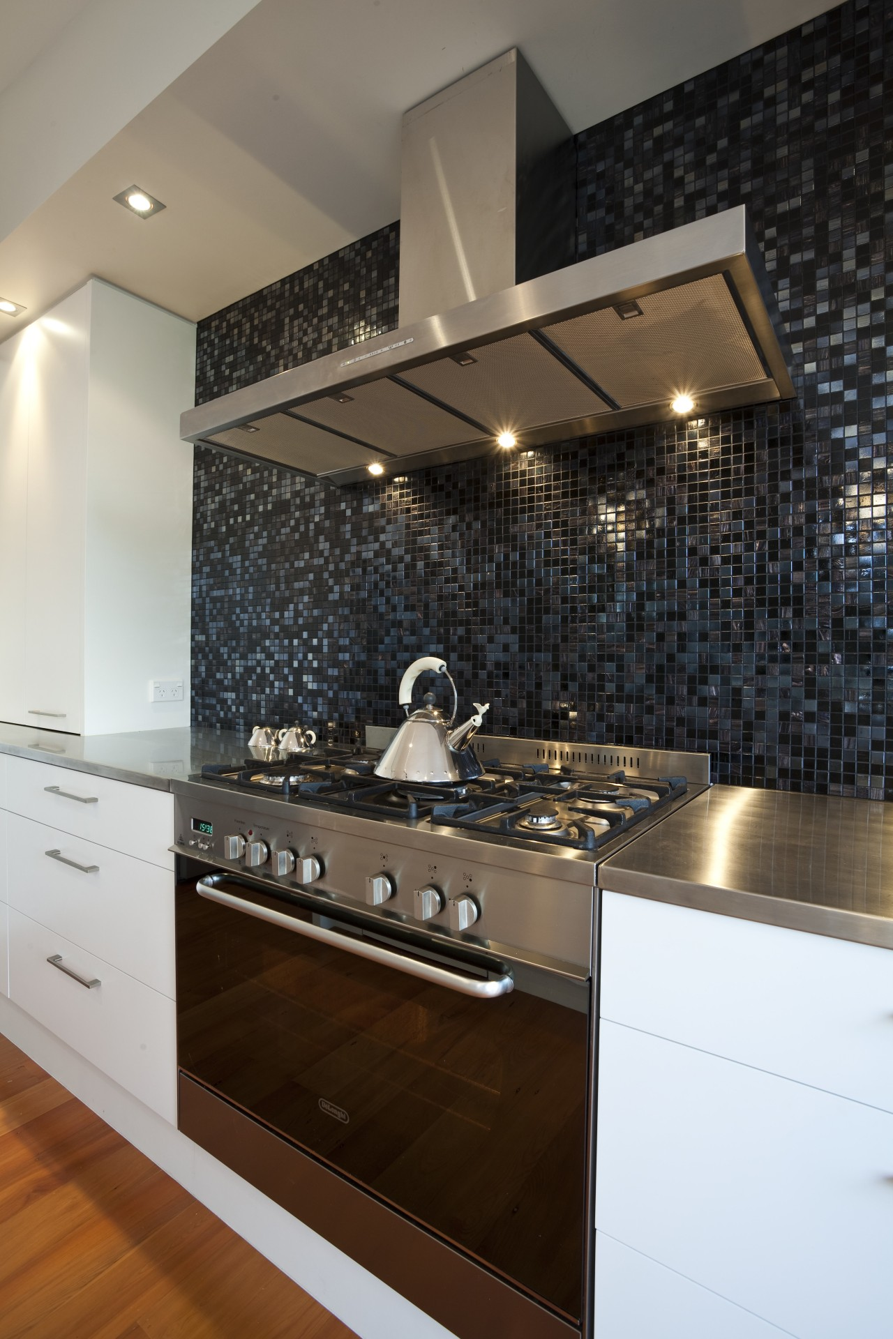 Kitchen designed by Yellow Fox, manufactured by Quality ceiling, countertop, flooring, interior design, kitchen, room, under cabinet lighting, black, brown