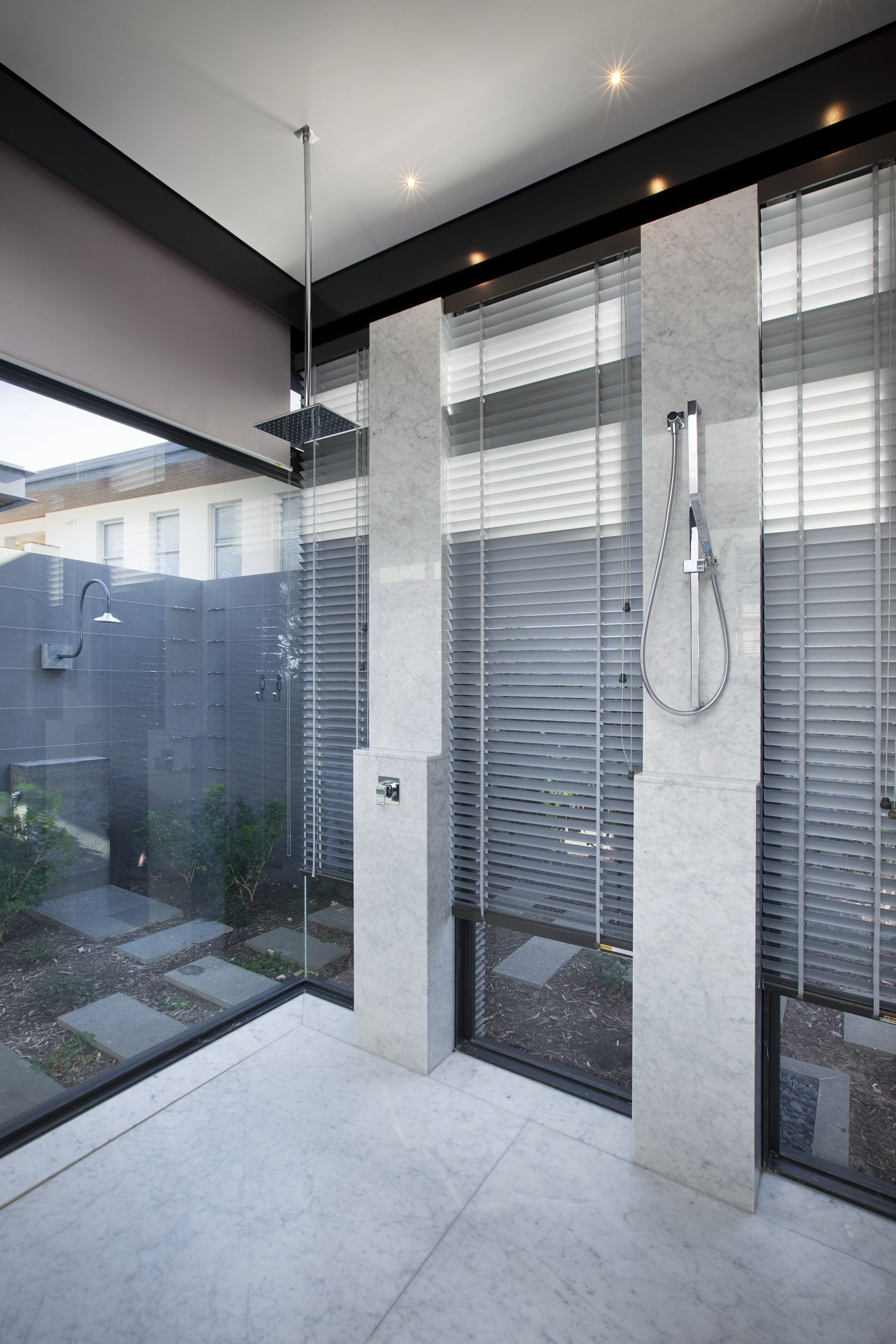 In this modern master suite, a large double architecture, bathroom, door, glass, interior design, gray