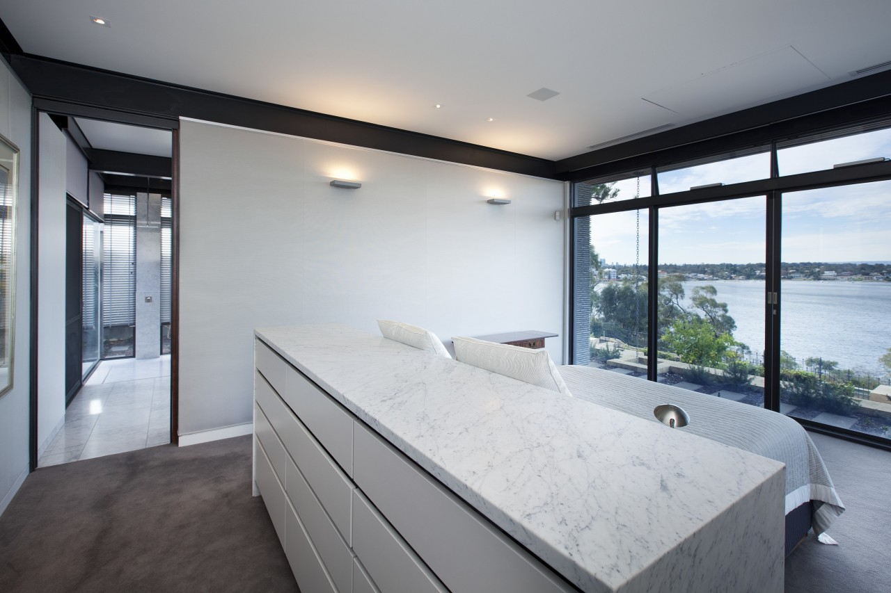The master bed in this modern master suite apartment, architecture, estate, house, interior design, property, real estate, room, window, gray