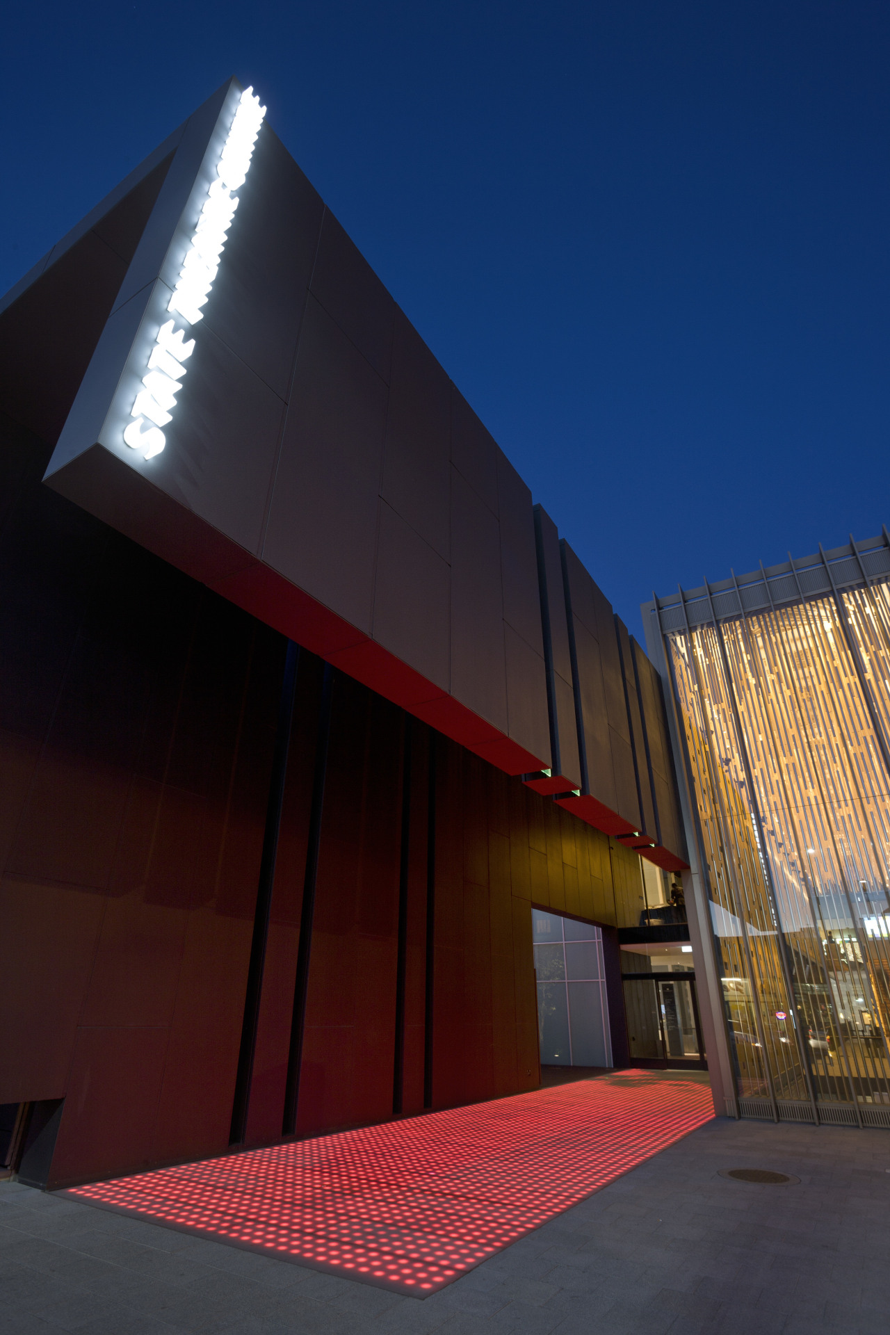 This is the Perth State Theatre, designed by angle, architecture, building, daylighting, facade, house, landmark, light, line, roof, sky, structure, wood, red, blue, black