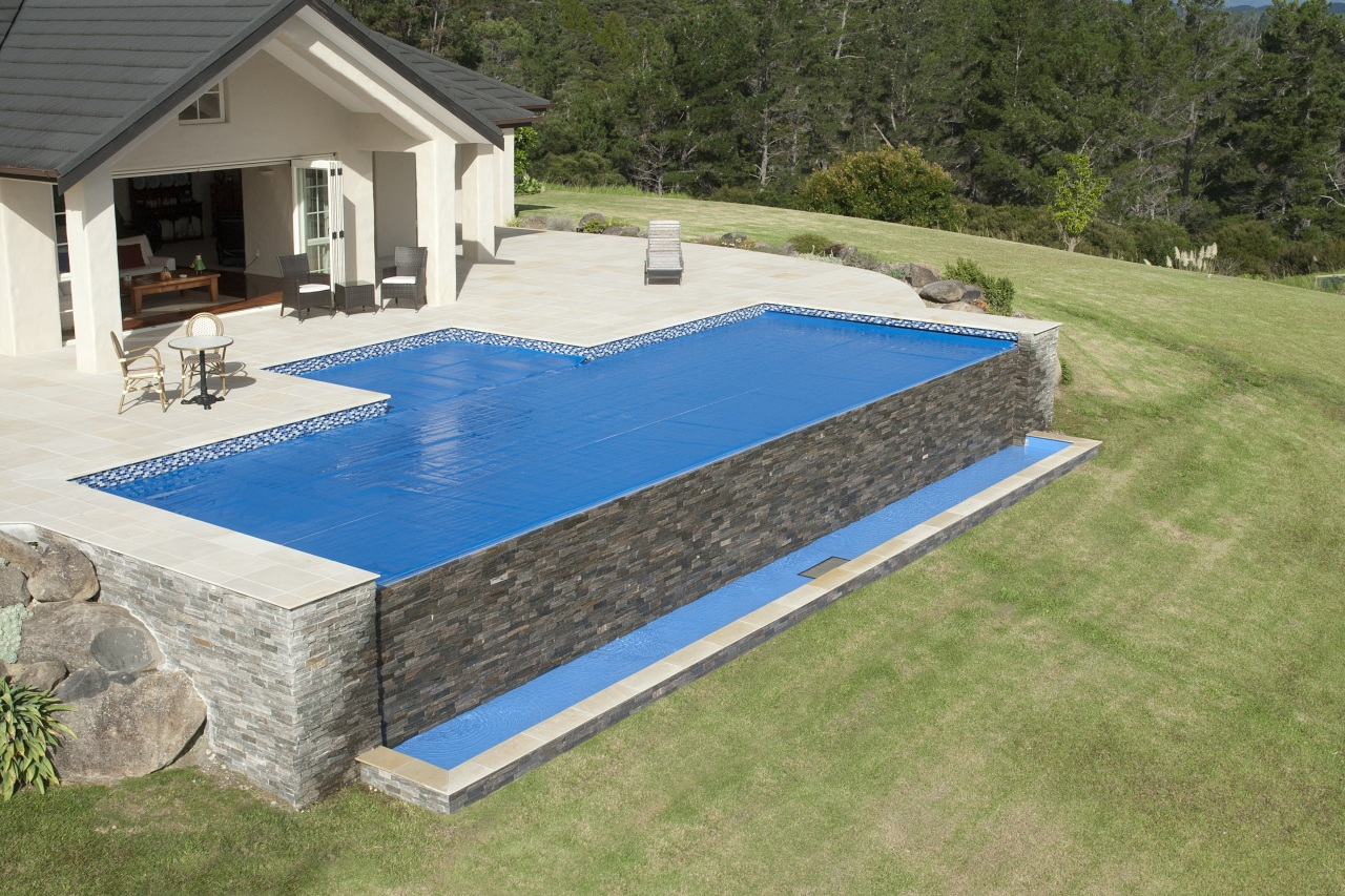This is a view of the pool designed backyard, grass, leisure, property, real estate, swimming pool, yard