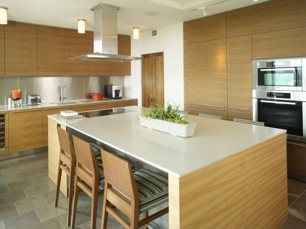 Architectural designer Mark Williams specified sleek Bulthaup walnut cabinetry, countertop, cuisine classique, floor, flooring, hardwood, interior design, kitchen, real estate, room, wood flooring, brown, orange
