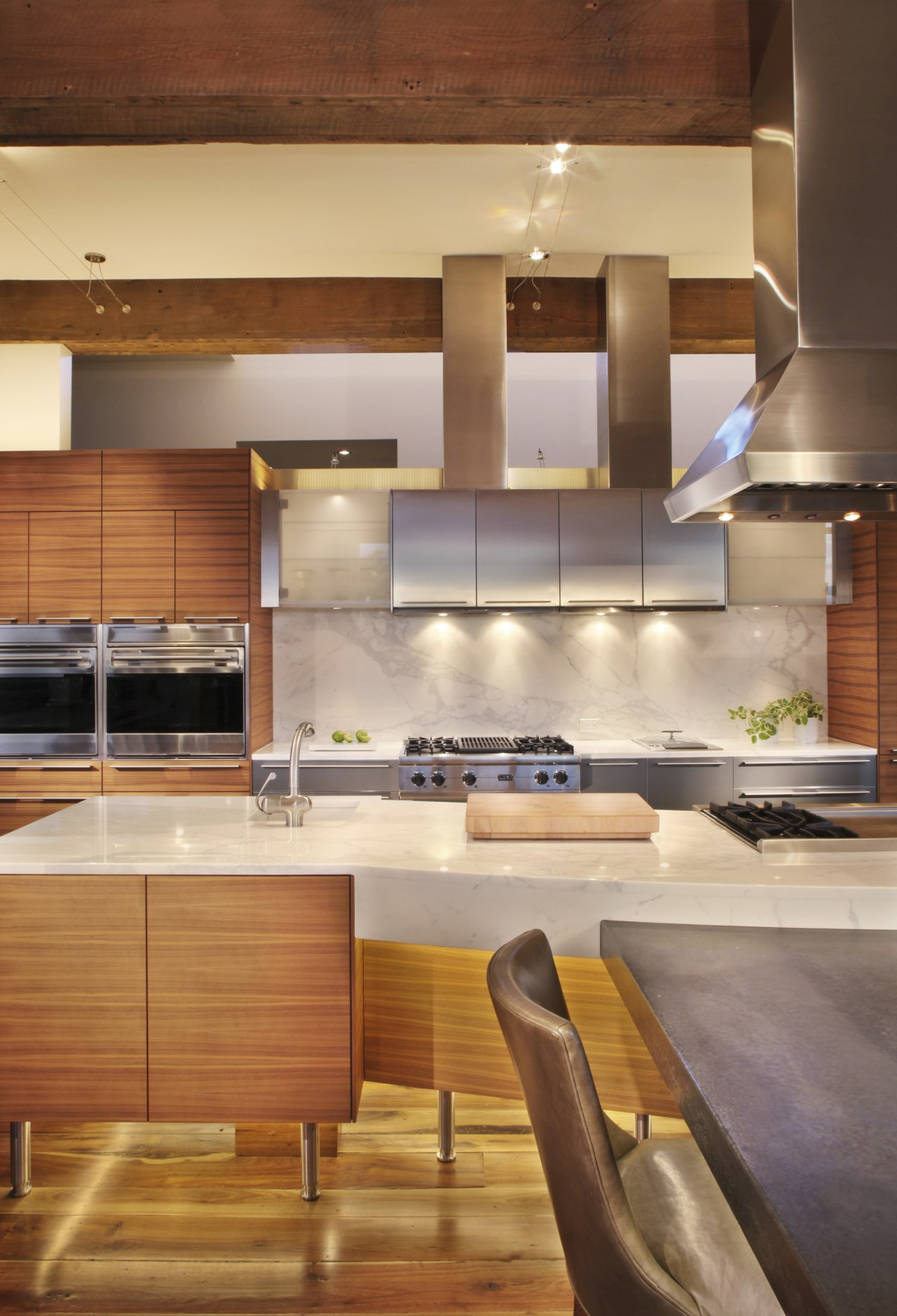 This kitchen was designed and manufactured by Bulthaup. cabinetry, ceiling, countertop, cuisine classique, hardwood, interior design, kitchen, under cabinet lighting, wood, wood flooring, orange, brown