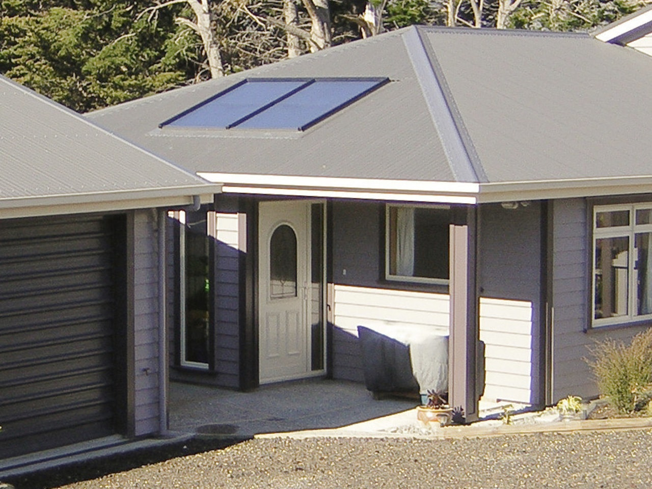 This large home efficiently uses solar energy thanks home, house, property, real estate, roof, siding, window, gray, black