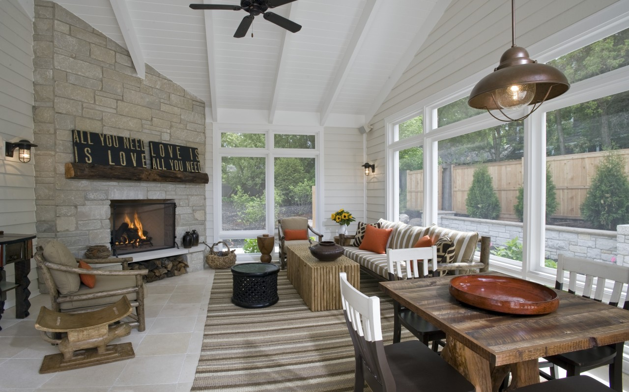 View of open plan dining and lounge area hearth, interior design, living room, outdoor structure, patio, porch, real estate, gray