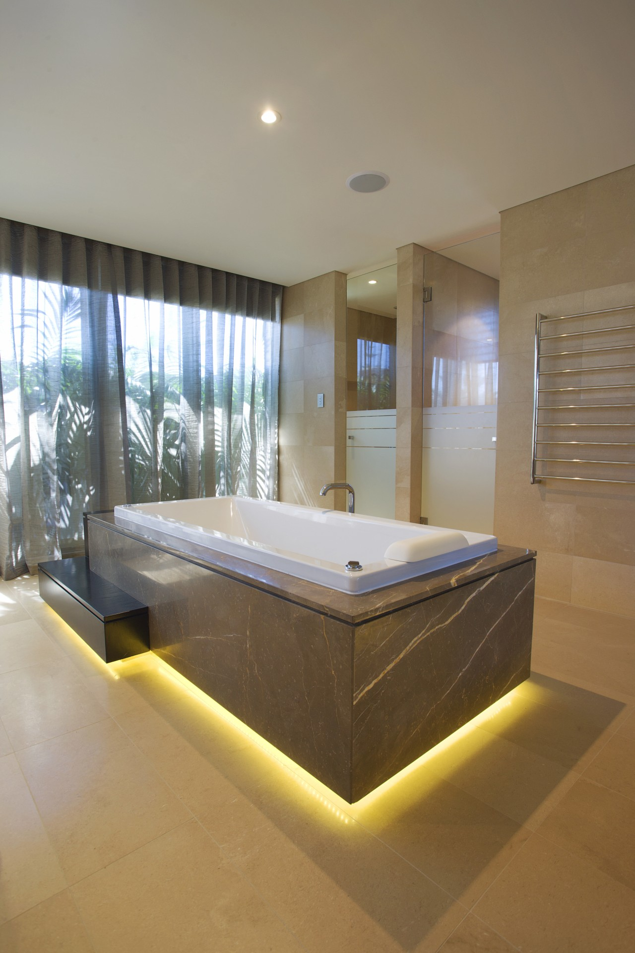Beige tub with lighting at the bottom. architecture, bathroom, bed frame, ceiling, daylighting, estate, floor, interior design, mattress, real estate, room, brown, gray