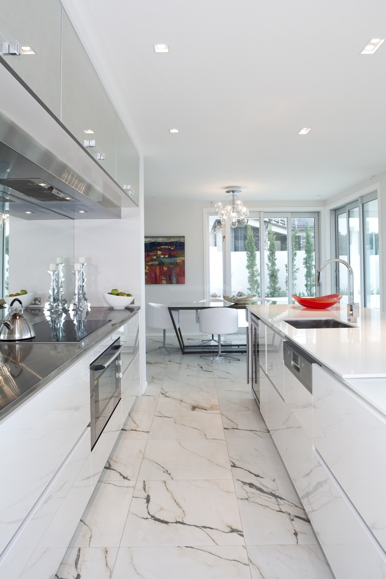 View of light toned kitchen with marble floor ceiling, countertop, floor, home, house, interior design, kitchen, real estate, room, white, gray