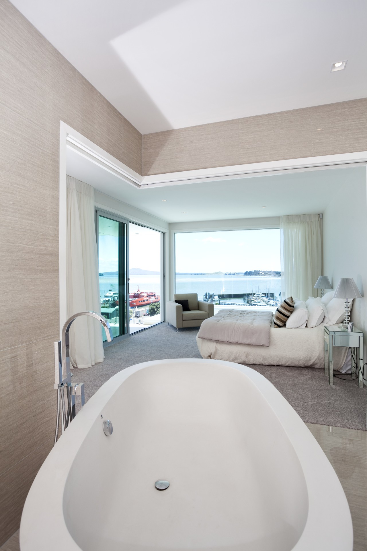 View of contemporary white tub in open plan architecture, bathroom, bathtub, daylighting, estate, floor, home, interior design, plumbing fixture, real estate, room, suite, gray, white