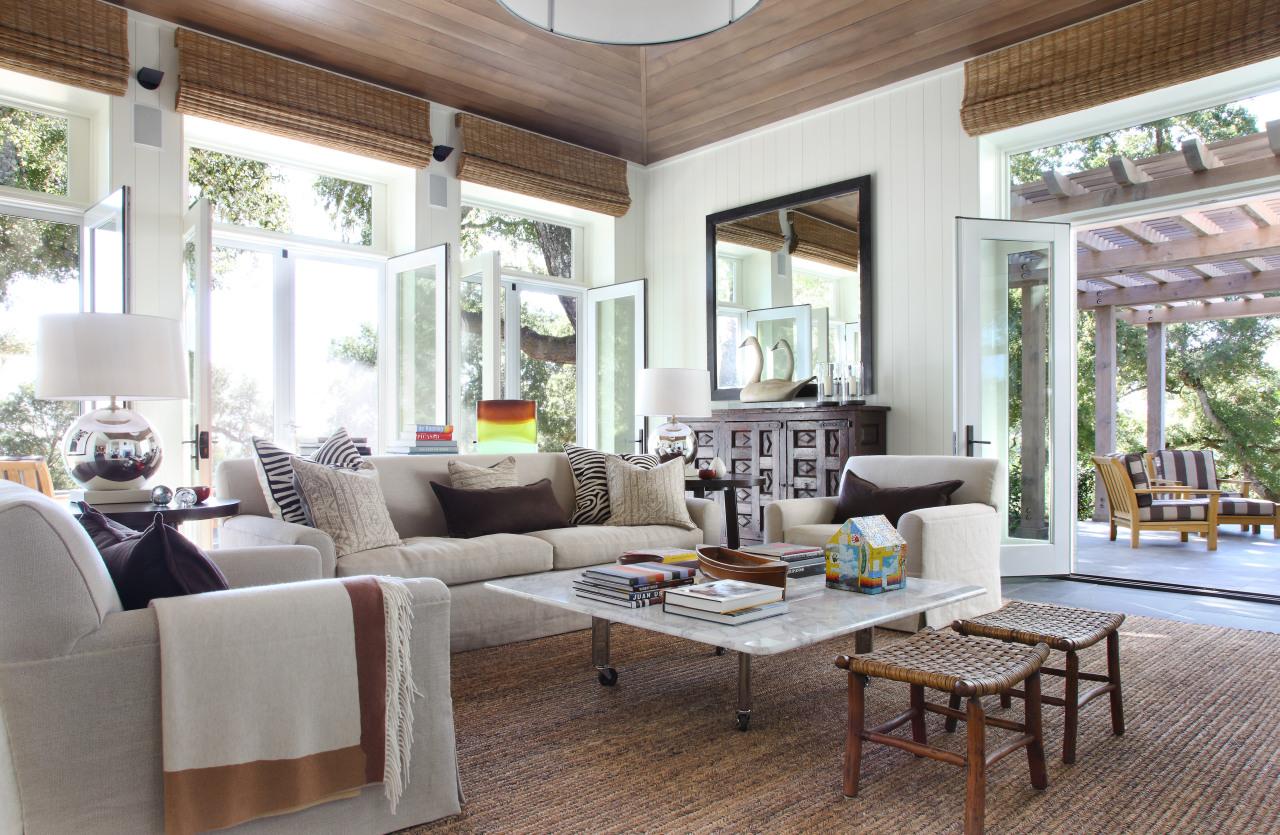 Lounge with cream sofas and floor matt. home, interior design, living room, real estate, room, window, white