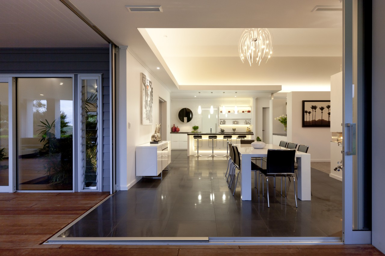view from outside decking past dining room through apartment, ceiling, floor, flooring, home, house, interior design, living room, lobby, real estate, window, wood flooring, orange