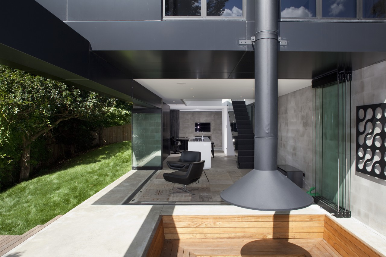 Black exterior, chimney, outside house looking at patio architecture, house, interior design, real estate, black, gray
