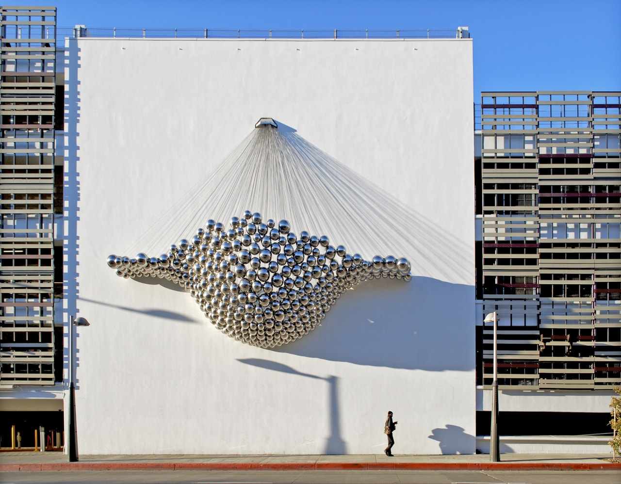 Sculpture on wall. architecture, building, facade, sky, structure, tower block, white