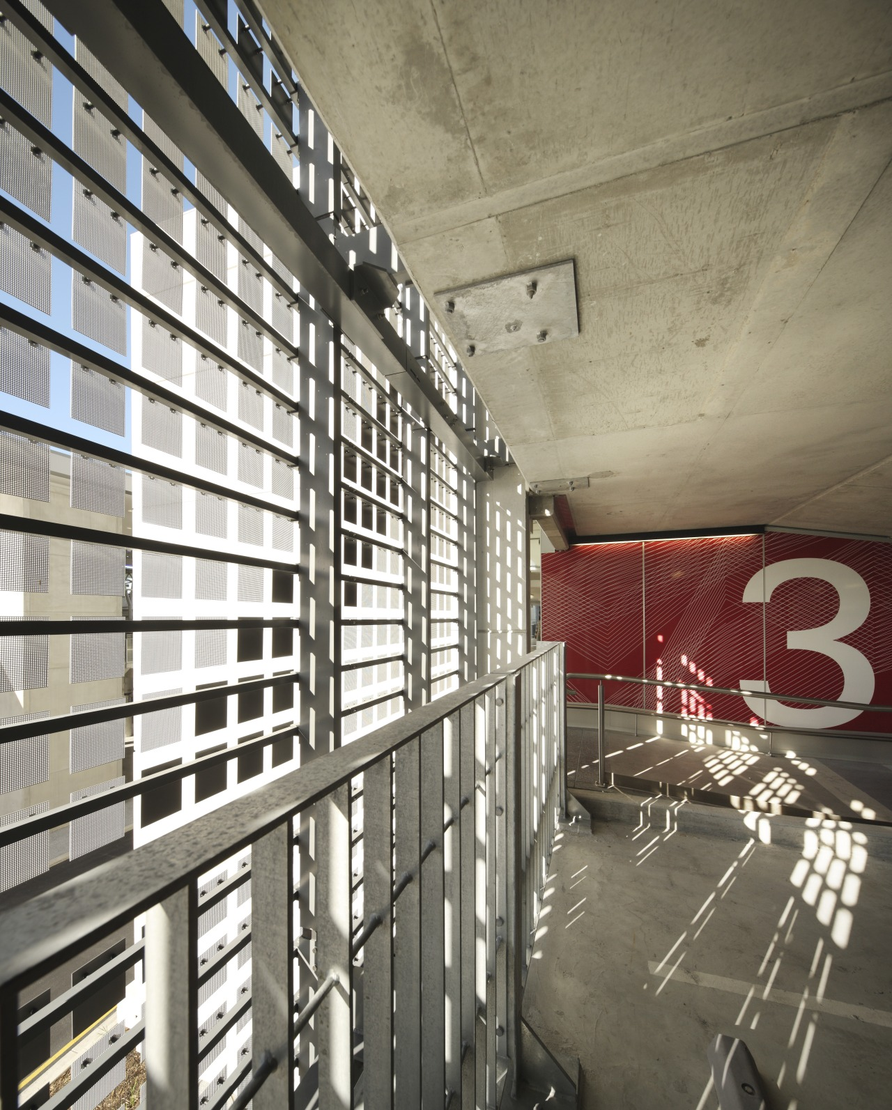 Interior with red wall and number 3. architecture, building, ceiling, daylighting, interior design, gray, white