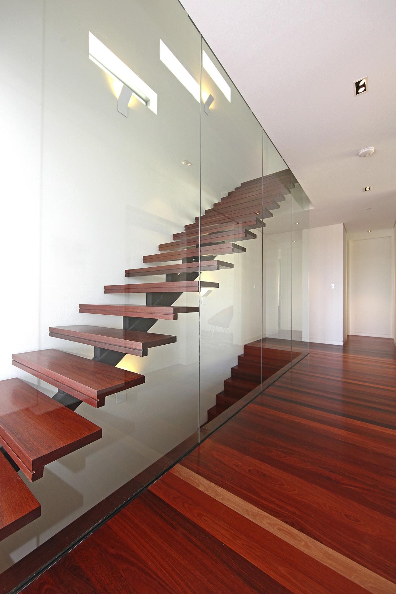 Wooden stairs and flooring. architecture, daylighting, floor, flooring, glass, handrail, hardwood, interior design, laminate flooring, stairs, wall, wood, wood flooring, white, red