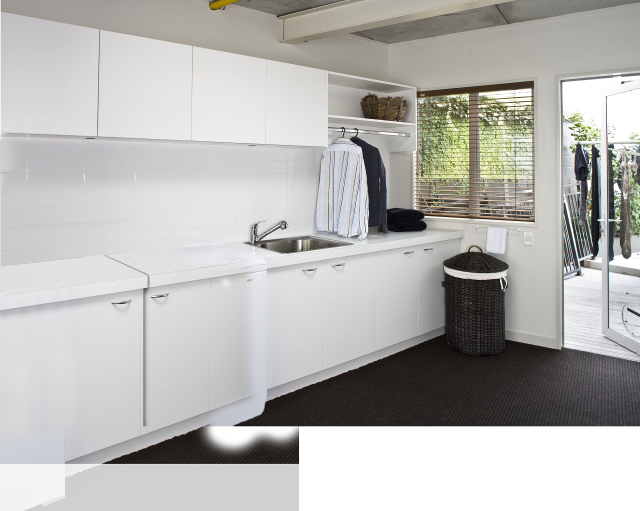 Laundry with white appliances and white cupboards. countertop, floor, interior design, kitchen, product design, room, white