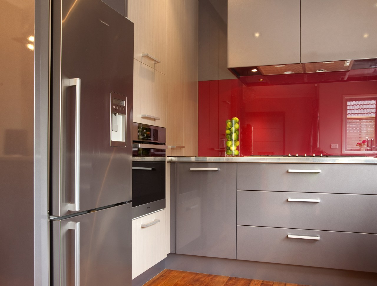 Streamlined grey kitchen with red accents. Grey cabinetry cabinetry, countertop, cuisine classique, home appliance, interior design, kitchen, room, gray
