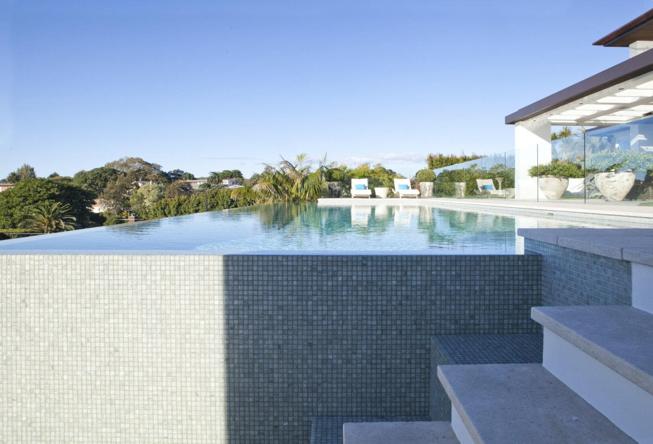 Overview of pool and stairs. condominium, estate, home, house, leisure, property, real estate, resort, swimming pool, villa, teal