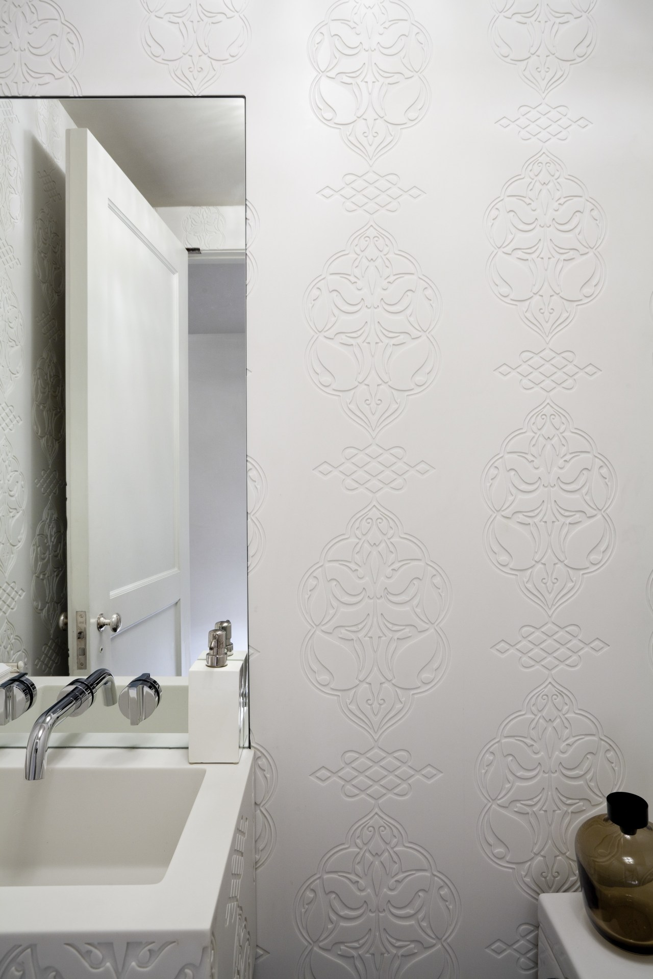 Custom-designed and fabricated Glacier White Corian clads every bathroom, ceramic, floor, flooring, interior design, plaster, plumbing fixture, product design, room, tap, tile, wall, white, gray