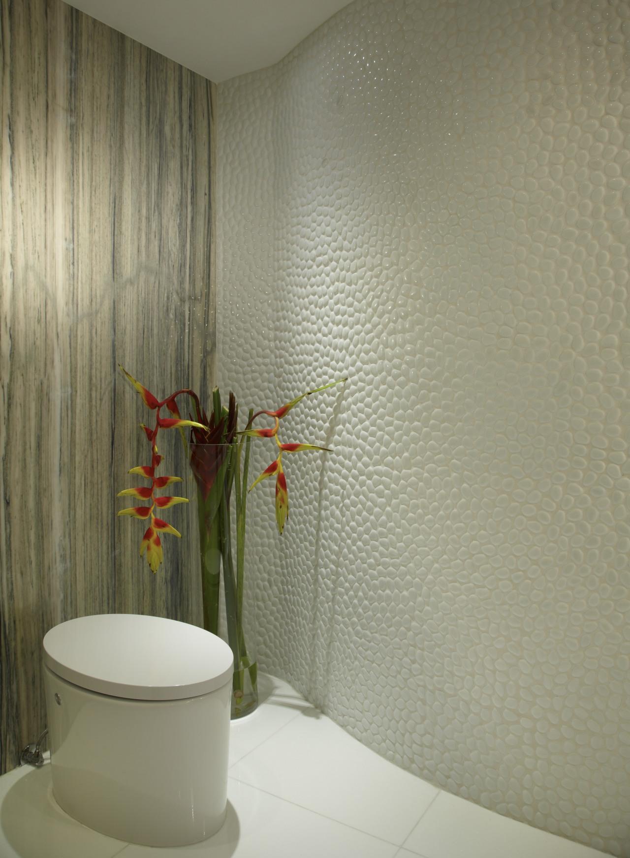 A curvaceous wall and contrasting textures create interest bathroom, ceramic, floor, flooring, interior design, plumbing fixture, room, tap, tile, toilet seat, wall, orange