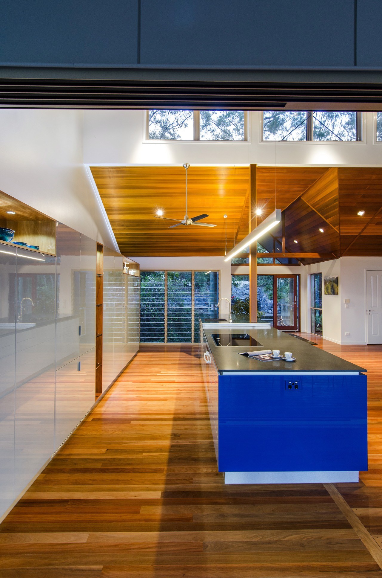 Strong architectural lines define this new kitchen. The architecture, ceiling, floor, flooring, house, interior design, brown