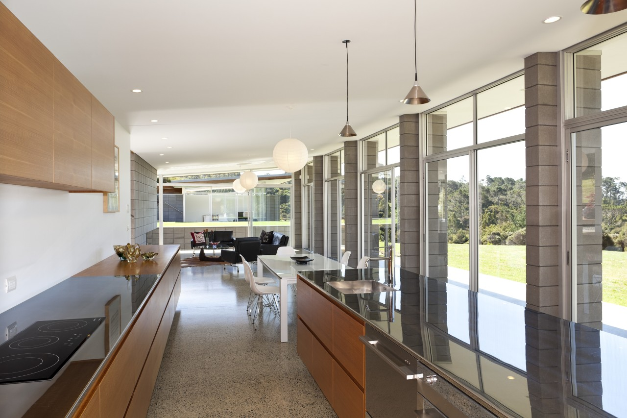 Concrete block columns, walls of glazing and a countertop, house, interior design, kitchen, real estate, white