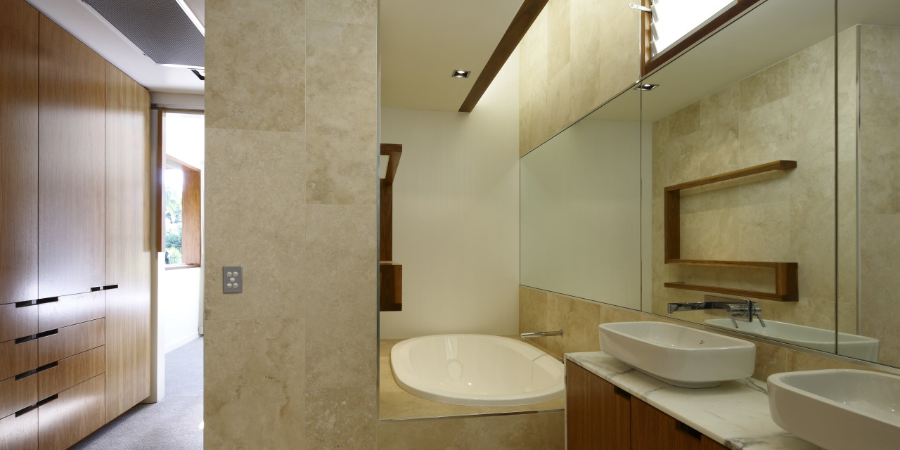 A picture of travertine tile, mirror and warm architecture, bathroom, daylighting, home, interior design, real estate, room, brown