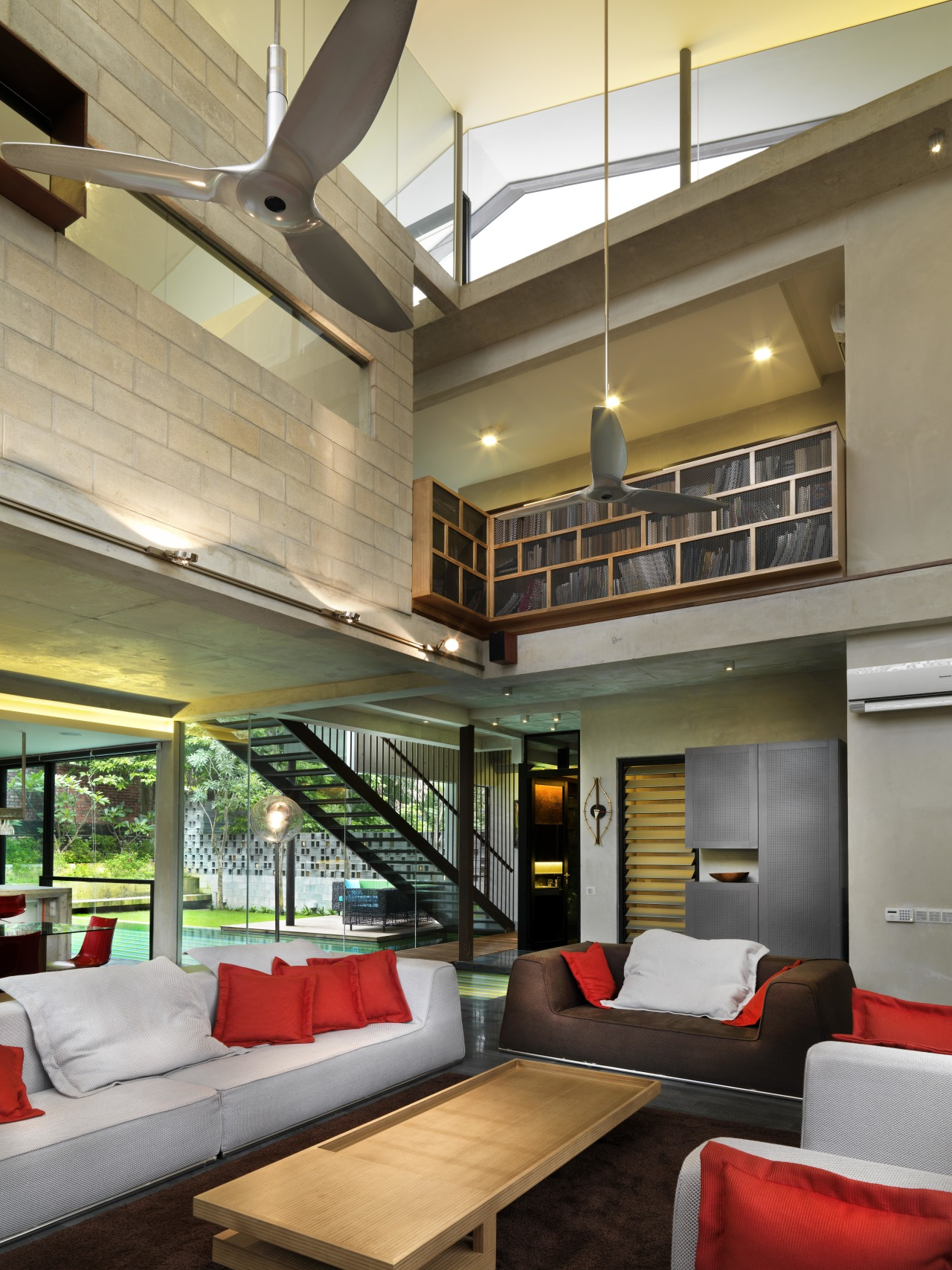 A double-height volume and exposed concrete formwork house architecture, ceiling, daylighting, interior design, living room, lobby, real estate, brown
