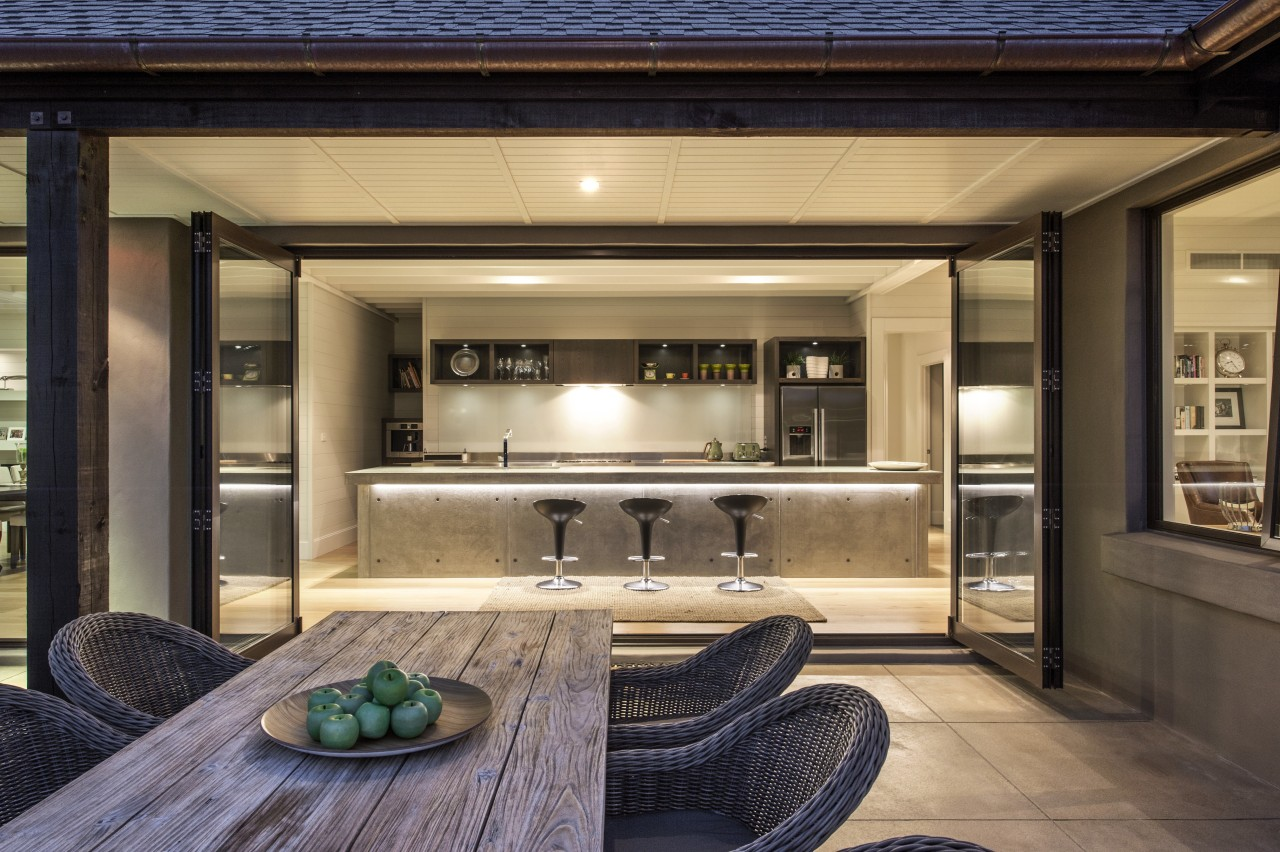 This contemporary, well-balanced masonry home was designed and interior design, real estate, black, brown, orange
