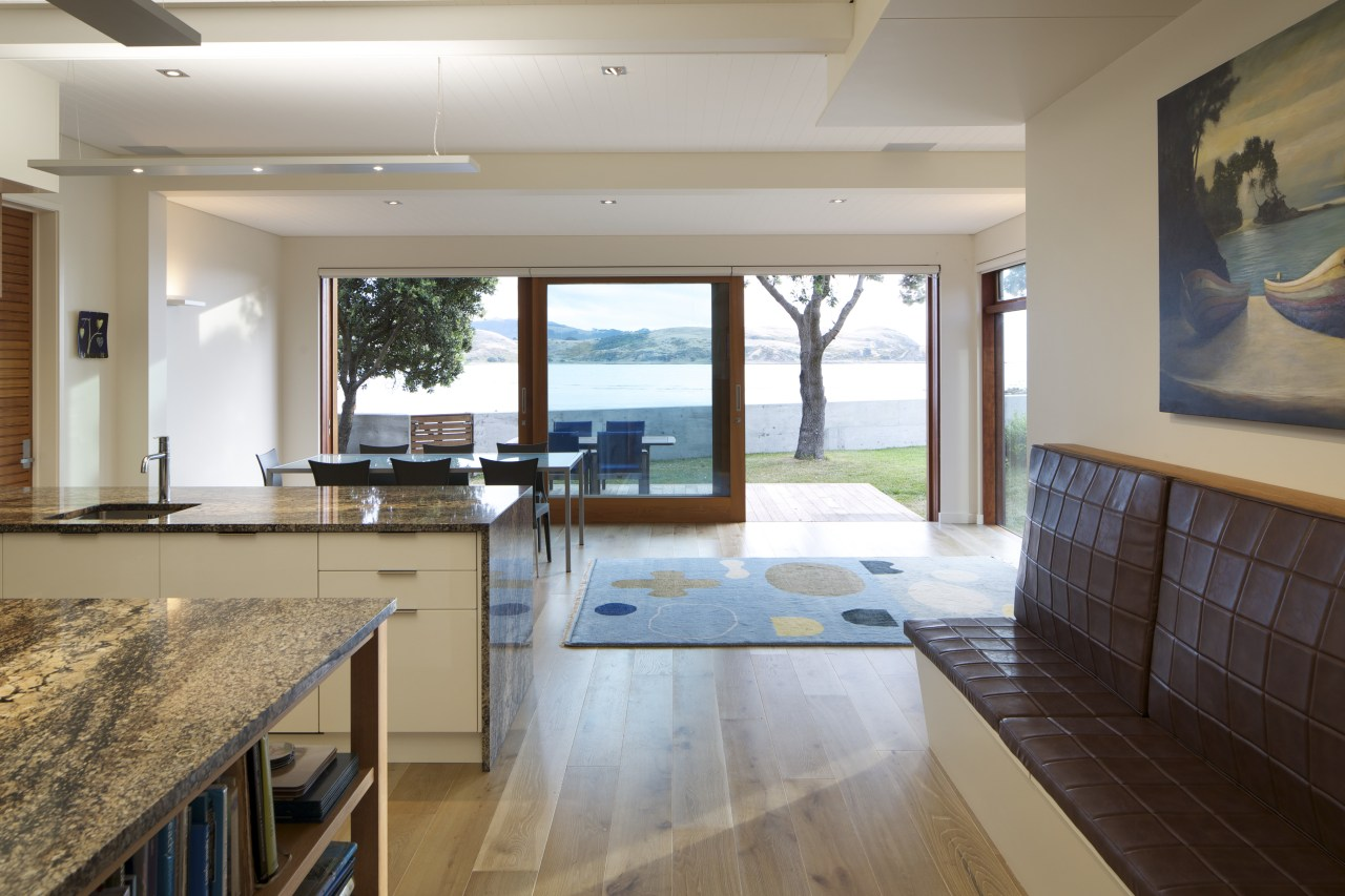 Coastal connections this house by Richard Middleton opens countertop, estate, floor, flooring, hardwood, house, interior design, kitchen, real estate, room, window, wood flooring, gray, brown