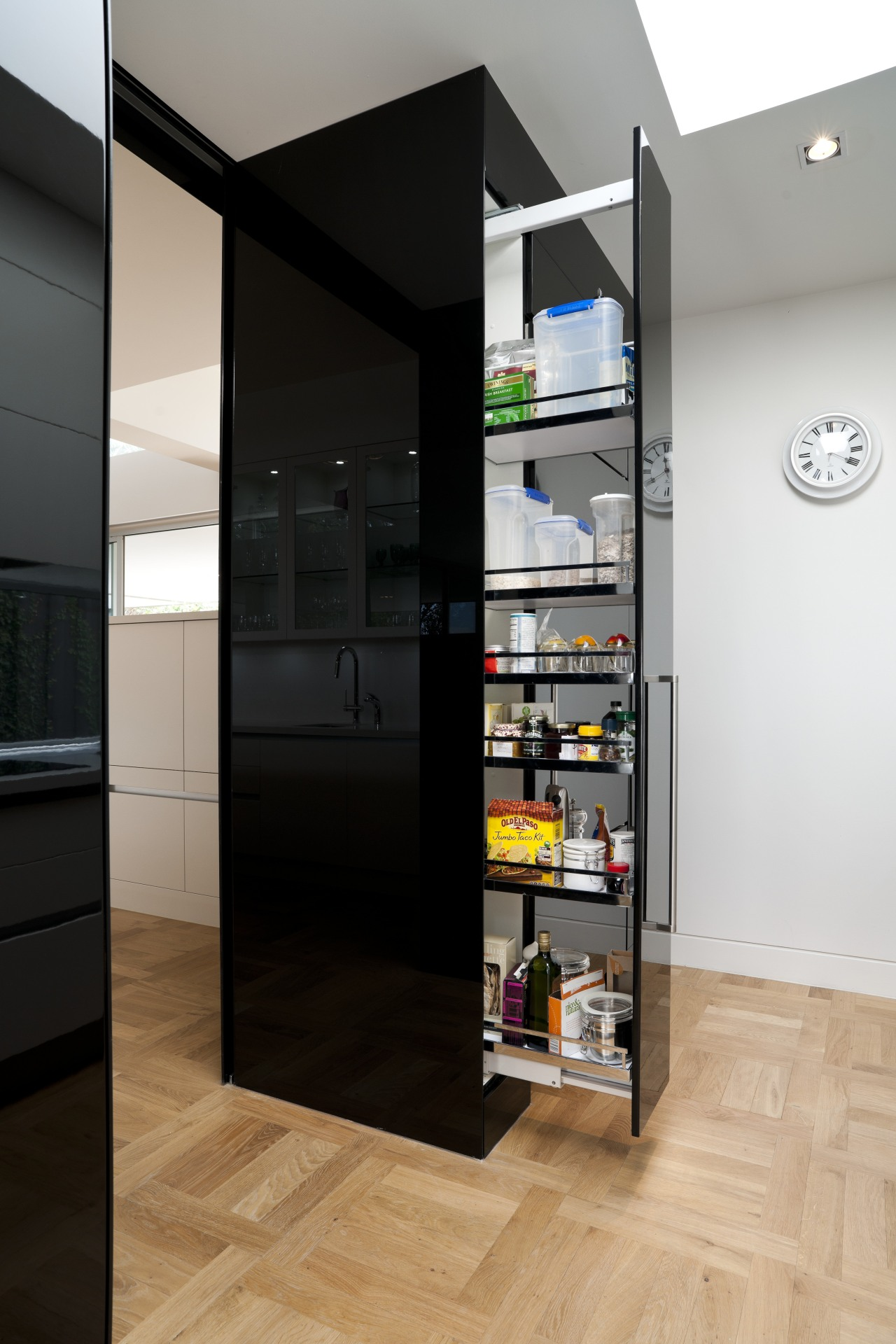 Black glass forms the sides of the cabinets cabinetry, floor, interior design, shelf, shelving, black, white