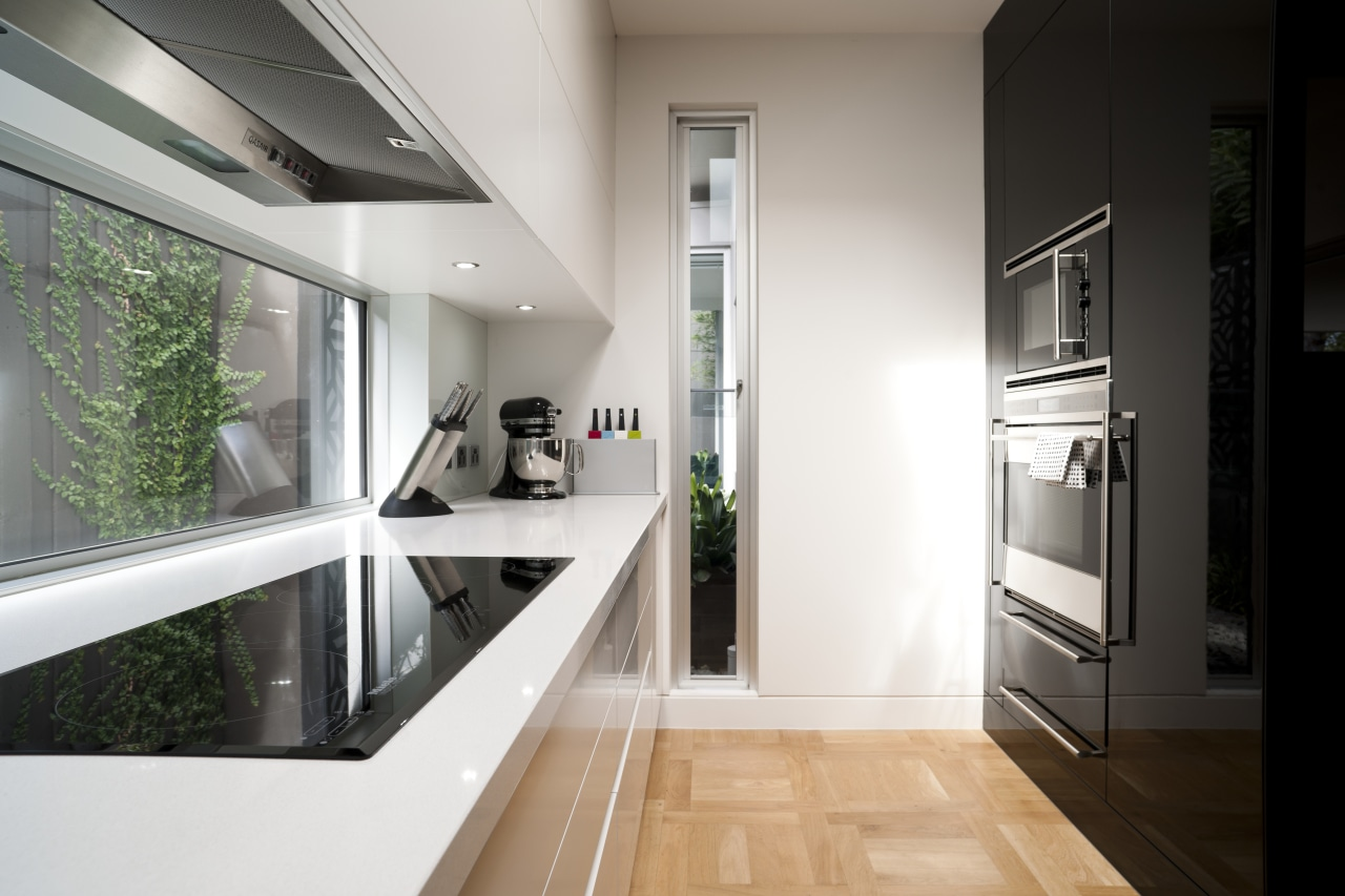 High-gloss black lacquer features on the front of interior design, kitchen, real estate, white, black