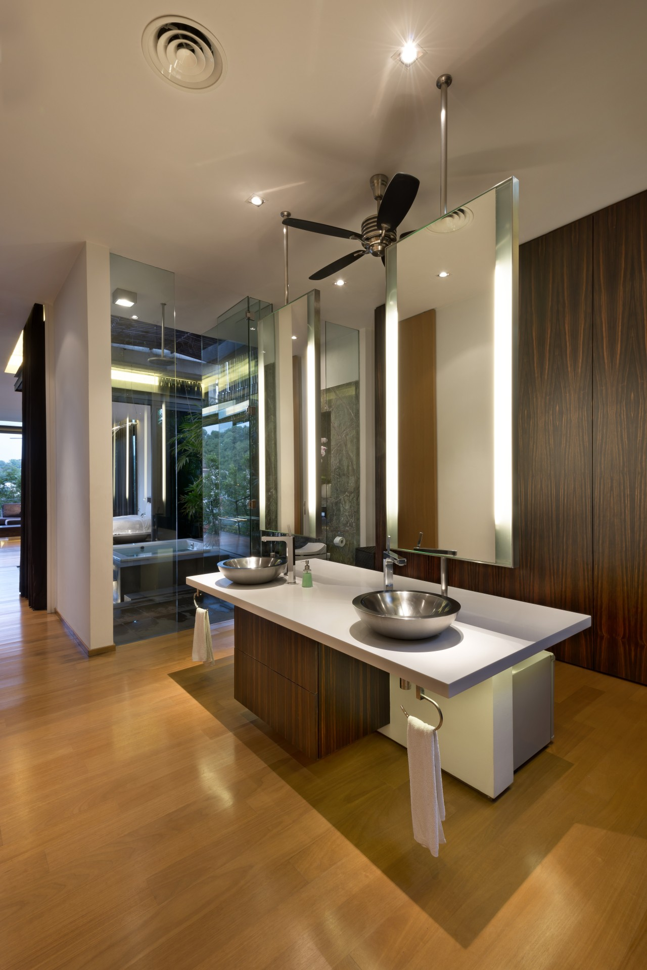 A freestanding, double-sided vanity unit appears suspended within ceiling, countertop, floor, flooring, hardwood, interior design, kitchen, laminate flooring, living room, real estate, room, table, wood flooring, brown