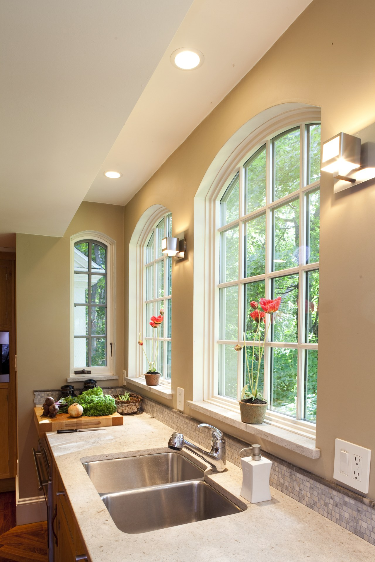 Arched windows enhance the classic appeal of this ceiling, countertop, daylighting, home, interior design, kitchen, real estate, room, window, orange