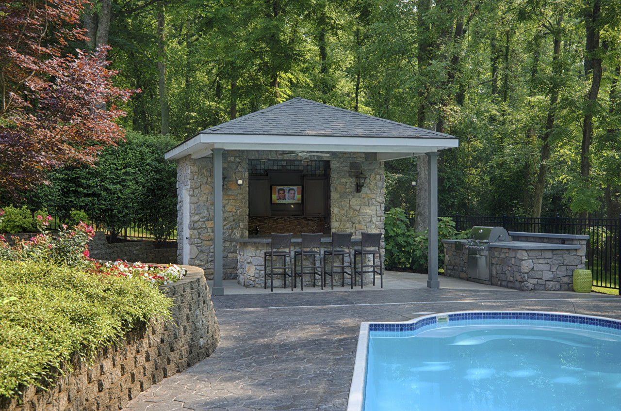 the existing pool house was also remodelled and backyard, cottage, estate, home, house, landscape, landscaping, outdoor structure, plant, property, real estate, shed, tree, water, yard, green