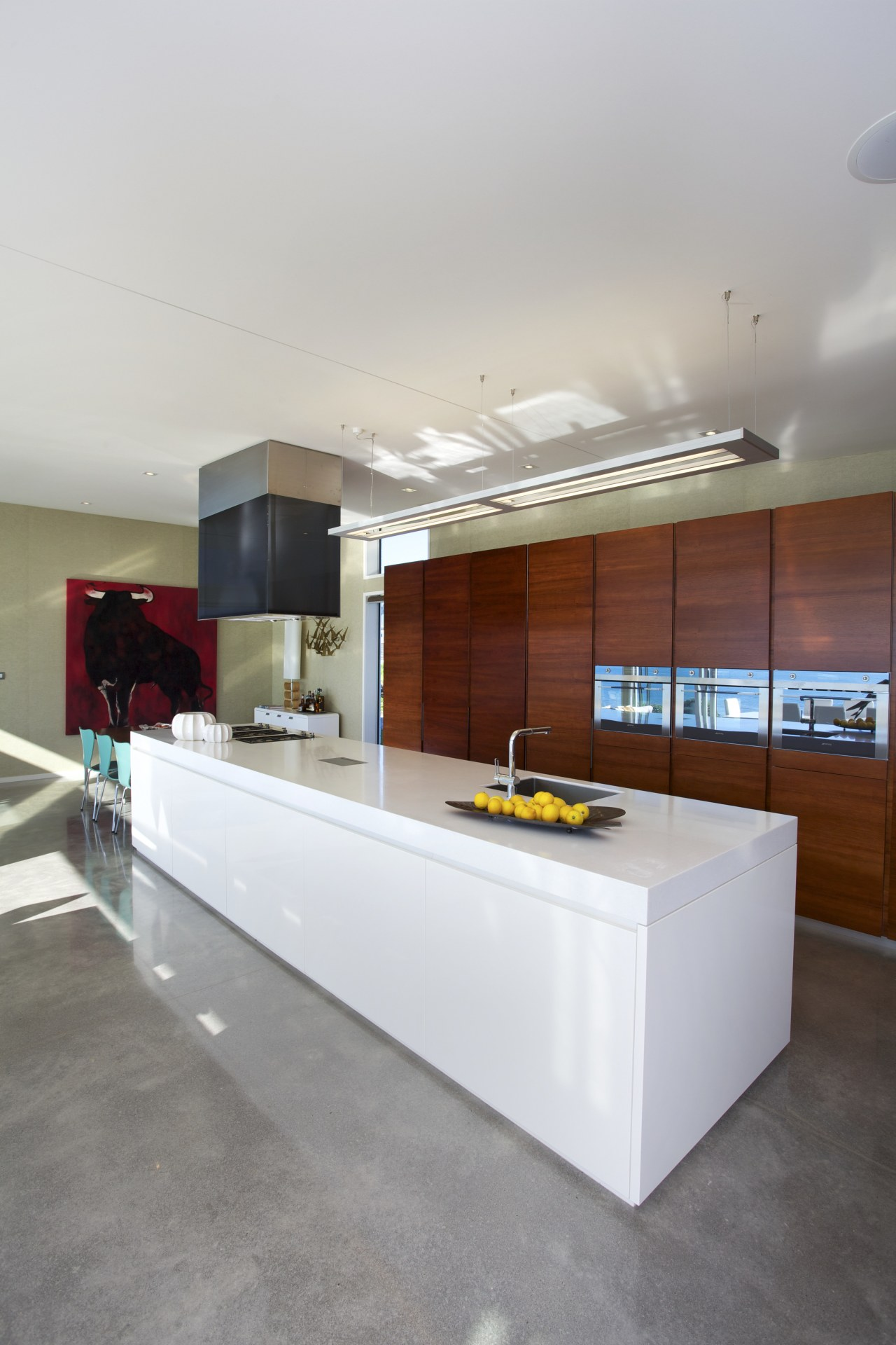 Timber cabinets conceal storage, a bar and fridge-freezer. architecture, countertop, floor, house, interior design, kitchen, gray, white