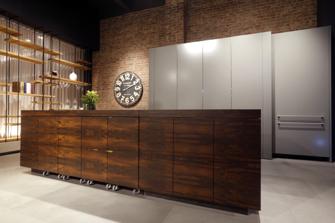 With its sleek, streamlined aesthetics, this kitchen blends cabinetry, chest of drawers, furniture, interior design, kitchen, sideboard, wood, wood stain, brown, gray