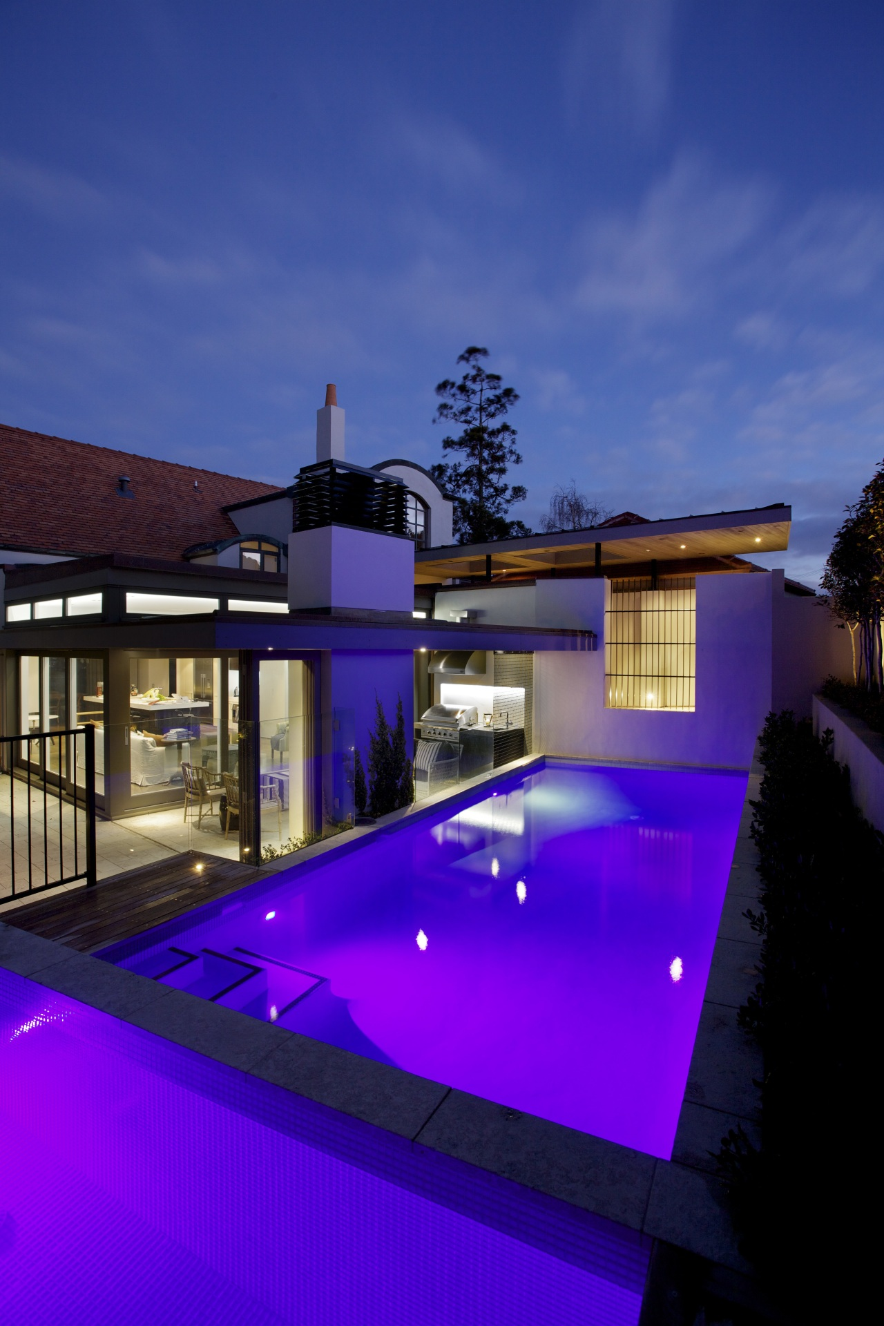Designed by architect Jennifer Hanson of A-Design Studio, architecture, daylighting, estate, facade, home, house, lighting, property, real estate, reflection, residential area, sky, swimming pool, blue