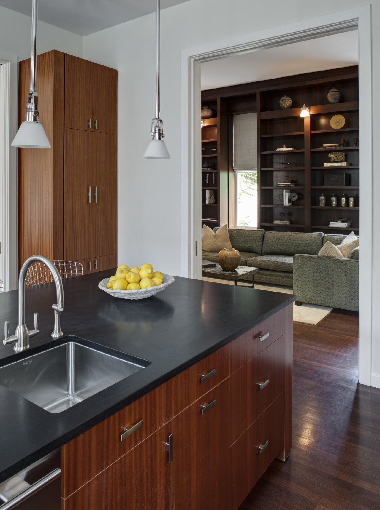 Crisp simplicity defines this contemporary kitchen in an cabinetry, countertop, cuisine classique, floor, flooring, hardwood, home appliance, interior design, kitchen, wood flooring, gray