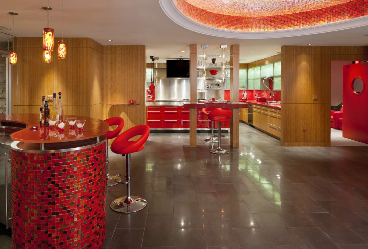 Bright red accents enliven this entertaining area in floor, flooring, interior design, lobby, restaurant, room, table, brown, red