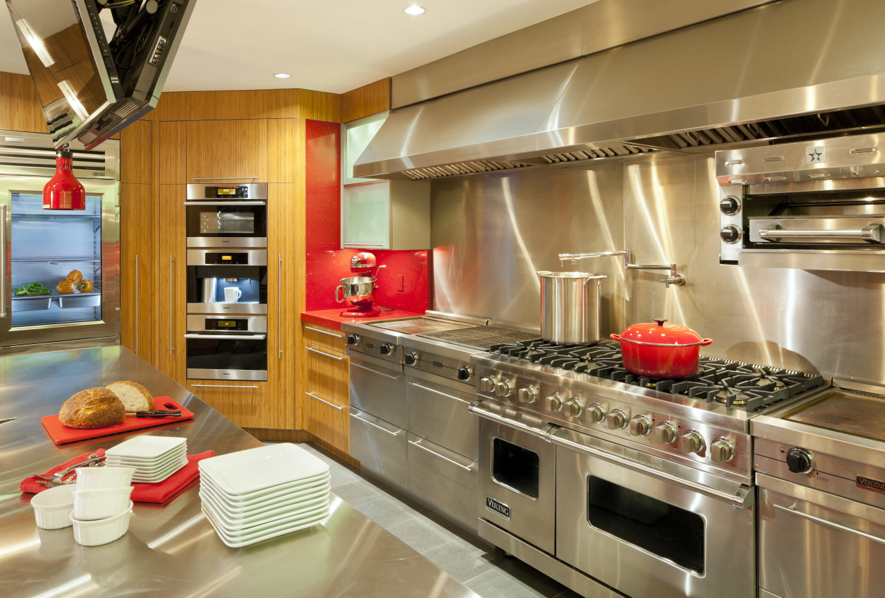With five ovens, warming drawers, griddles and a cabinetry, countertop, cuisine classique, interior design, kitchen, brown, orange