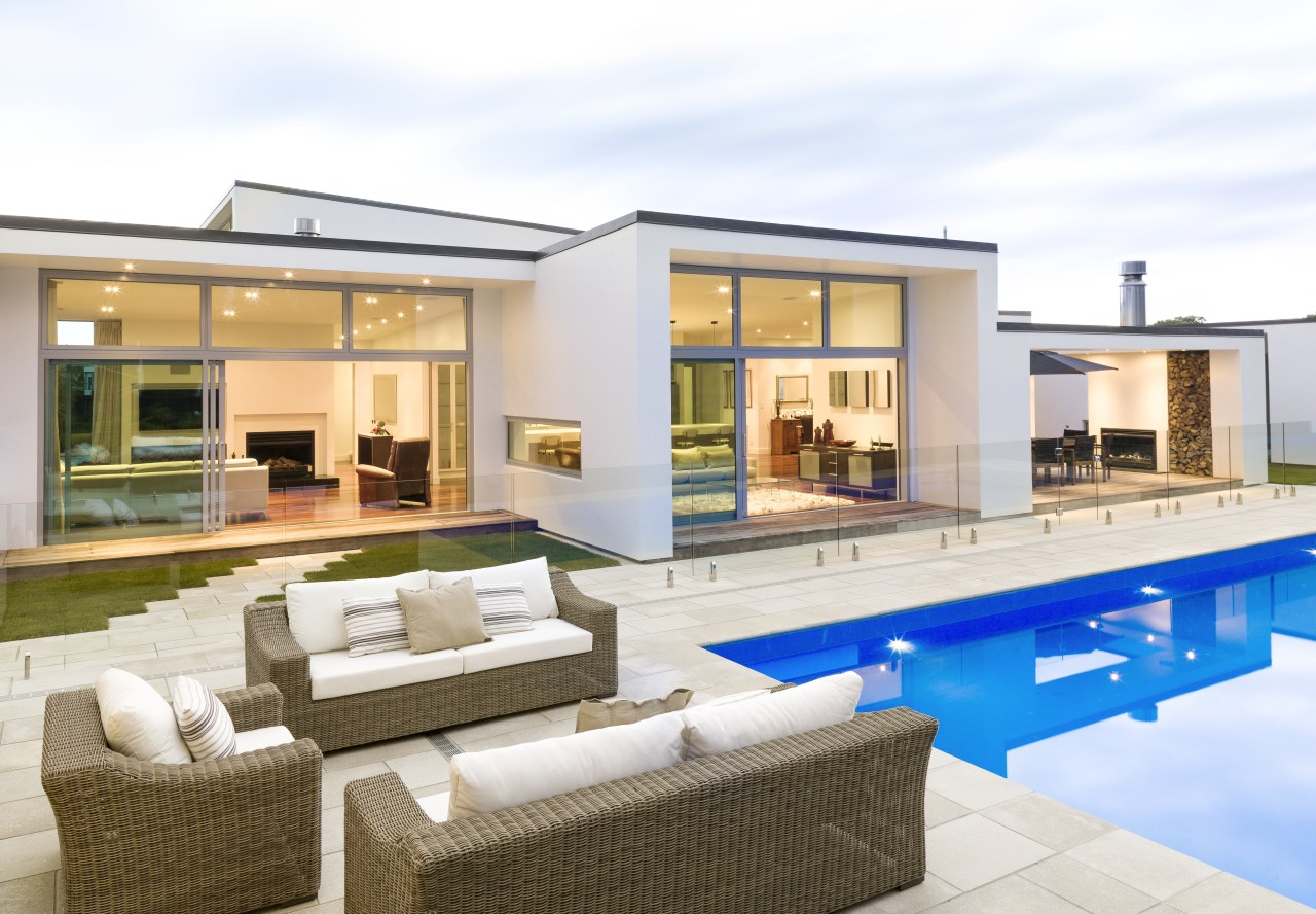 Modern family home with outdoor seating area. Aluminium apartment, estate, home, house, interior design, property, real estate, swimming pool, villa, window, white