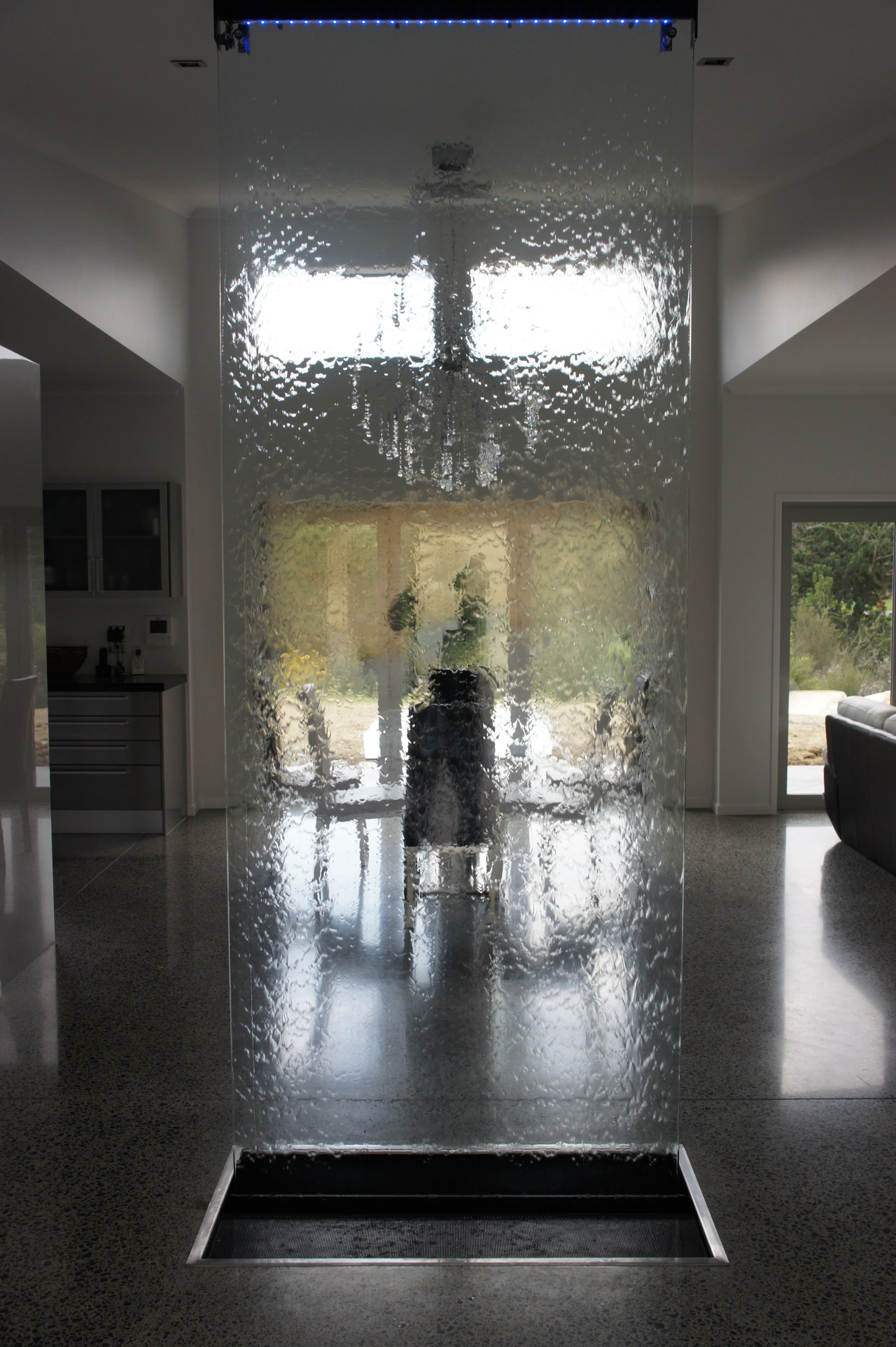 Waterworks indoor water feature.  A shimmering sheet architecture, ceiling, floor, flooring, glass, interior design, lobby, tourist attraction, wall, black