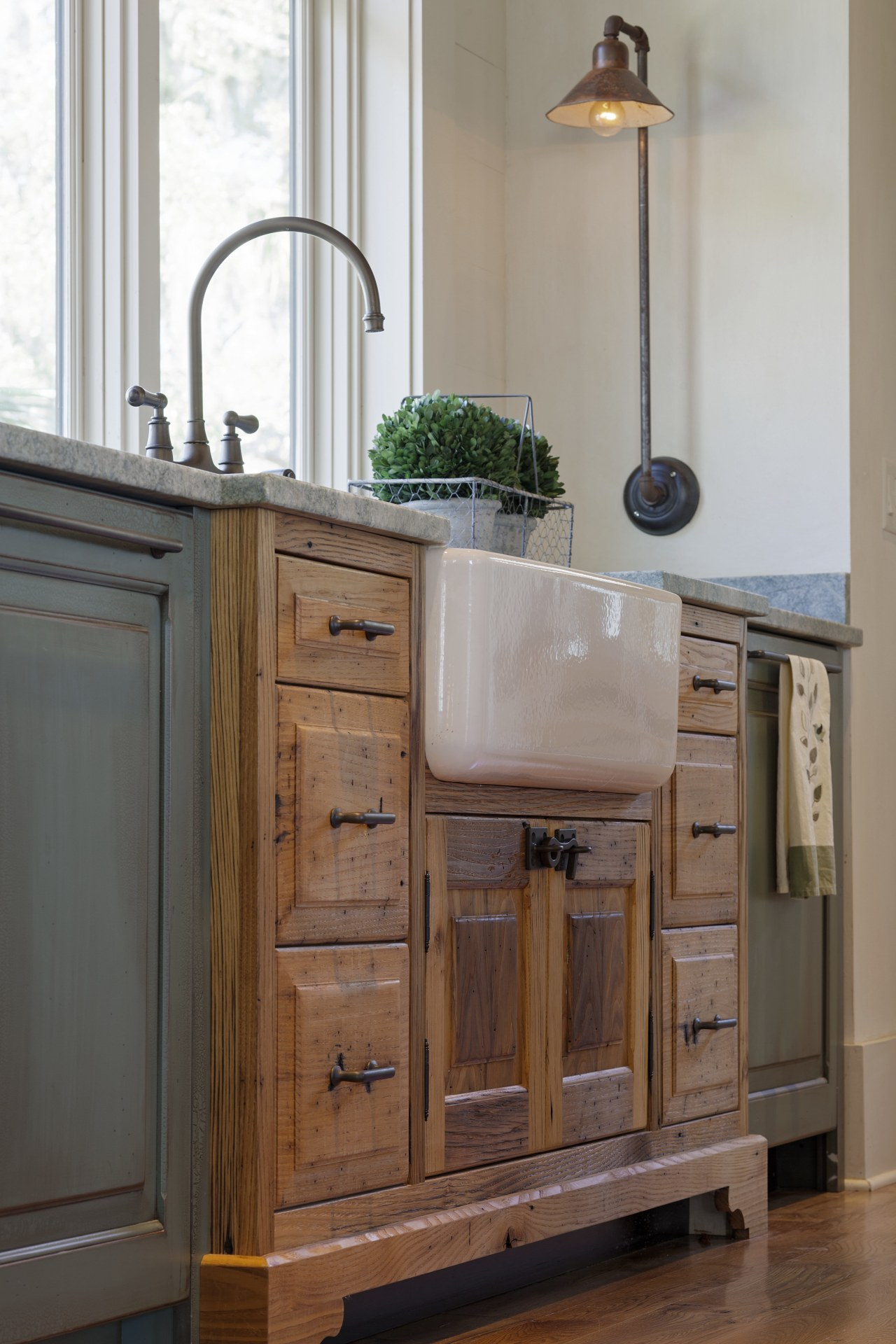 This sink cabinet juts out into the room, bathroom, bathroom accessory, bathroom cabinet, cabinetry, chest of drawers, countertop, cuisine classique, drawer, floor, furniture, hardwood, kitchen, room, sideboard, sink, wood, wood stain, gray, brown