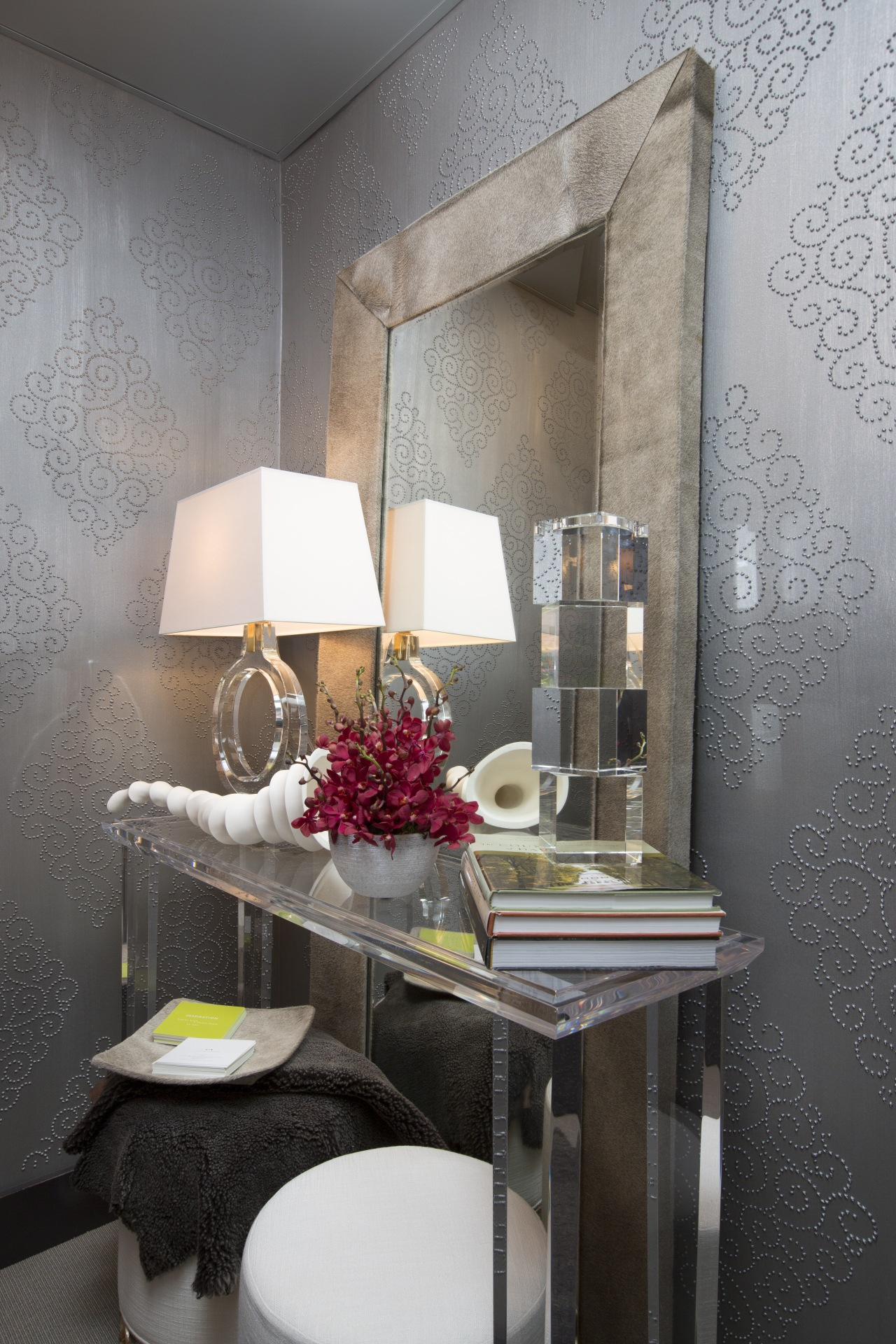 The clear acrylic table in this powder room chair, furniture, home, interior design, room, table, wall, gray, black