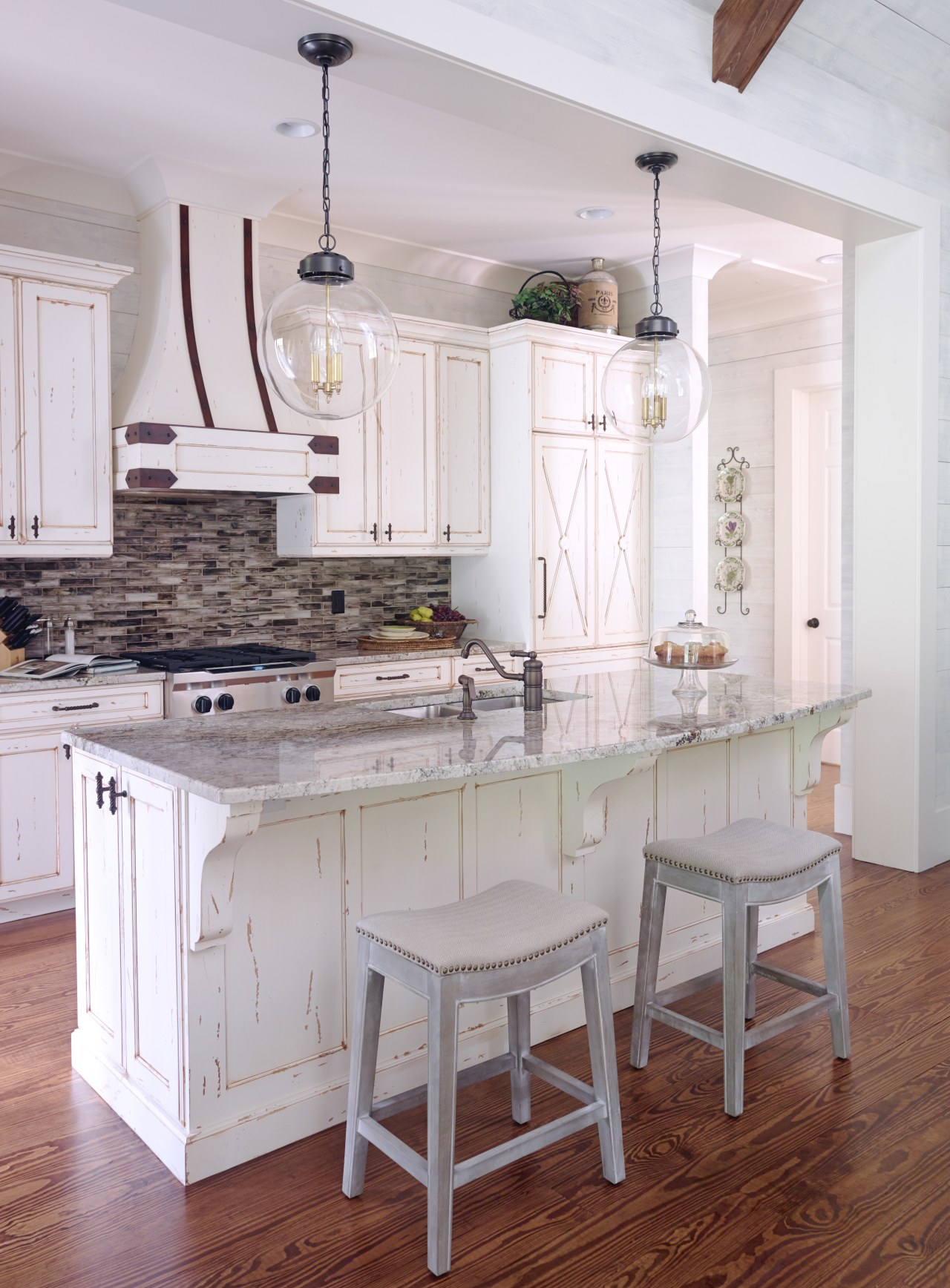 Distressed paint with the wood showing through helps cabinetry, countertop, cuisine classique, dining room, floor, flooring, furniture, hardwood, home, interior design, kitchen, room, table, wood flooring, gray, white