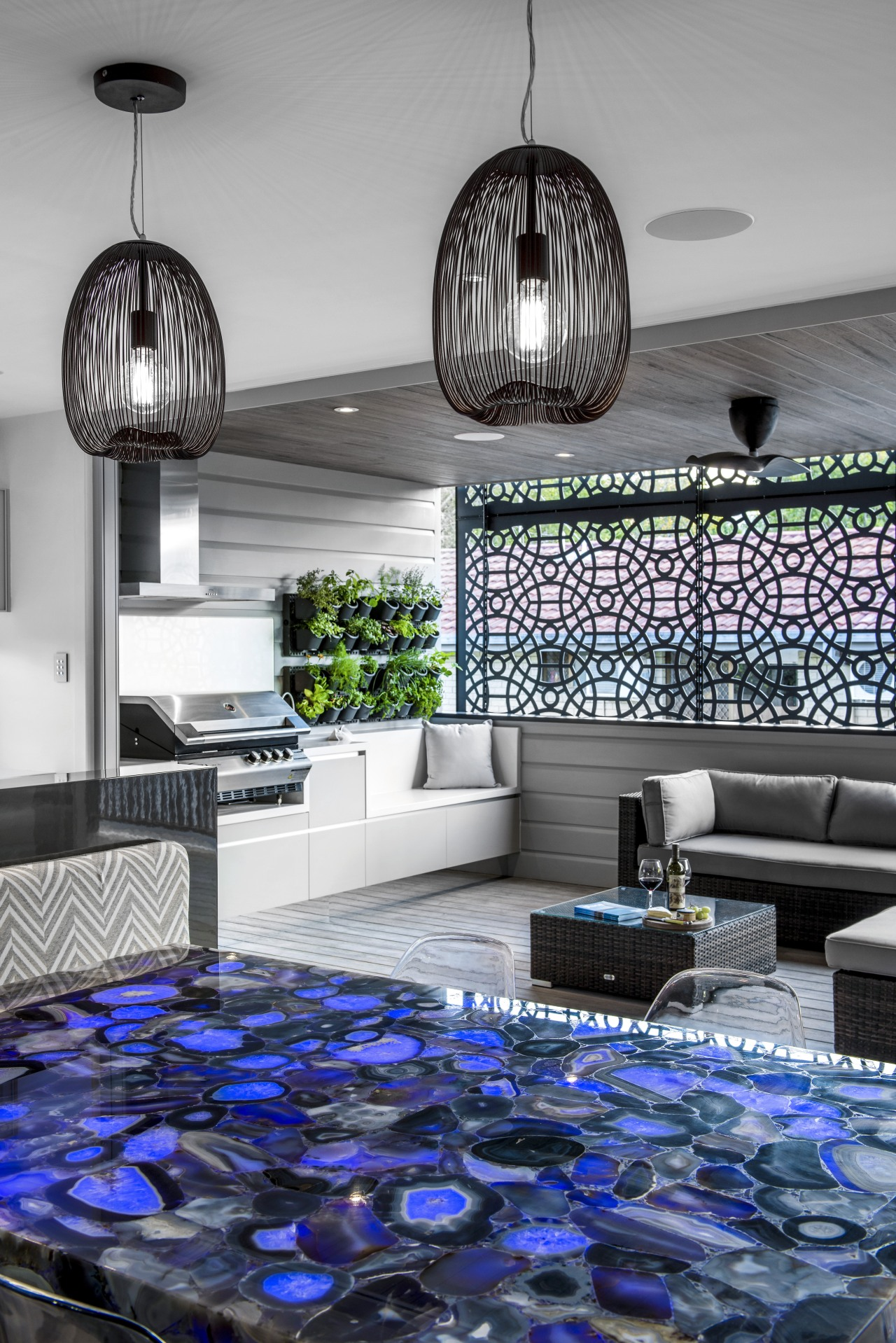 Created by designer Kim Duffin, this multi-use space architecture, blue, ceiling, home, interior design, light fixture, lighting, living room, purple, room, wall, gray
