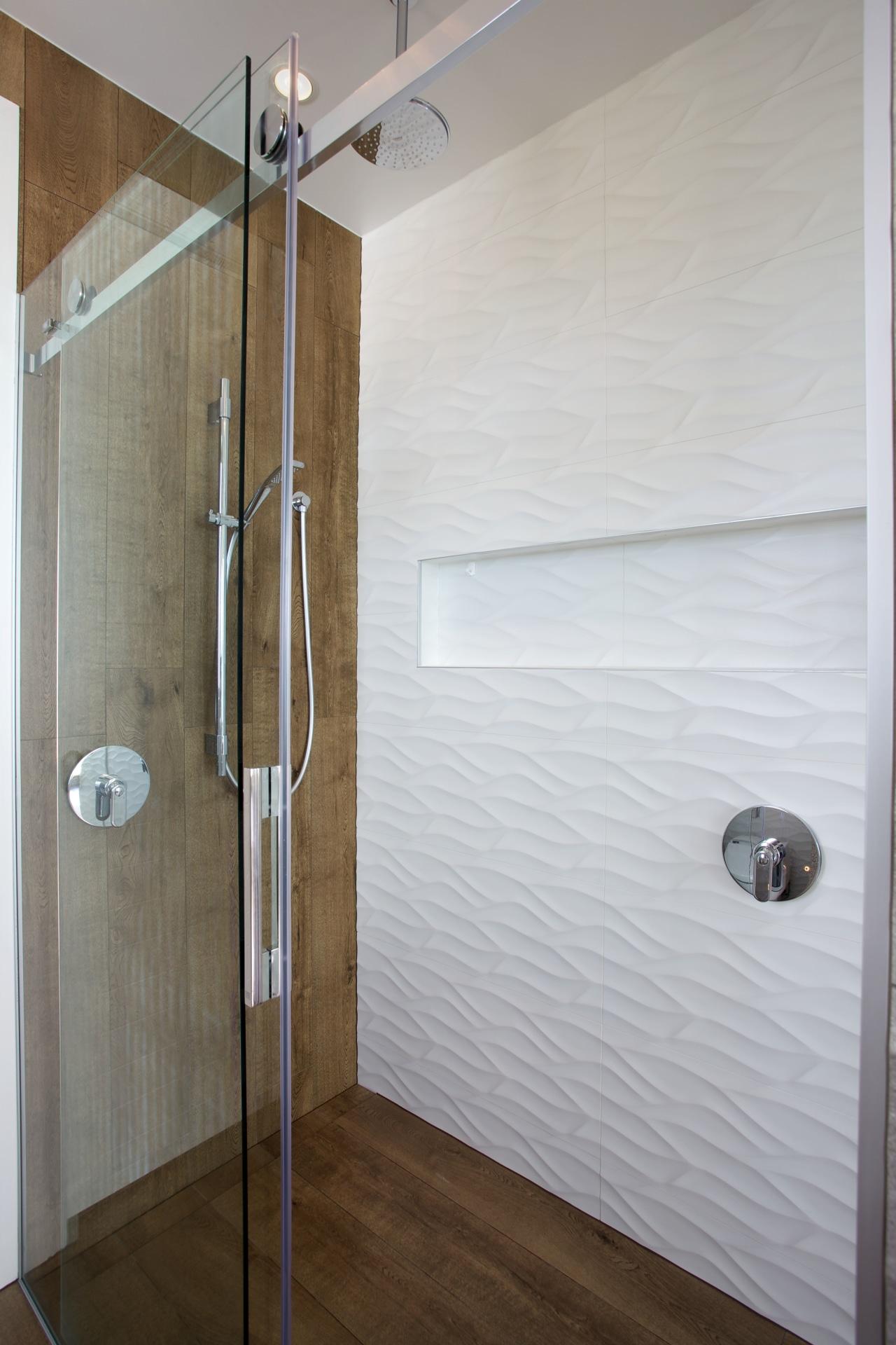 This  shower has a niche for shampoos, bathroom, door, floor, flooring, plumbing fixture, room, shower, tile, wall, gray