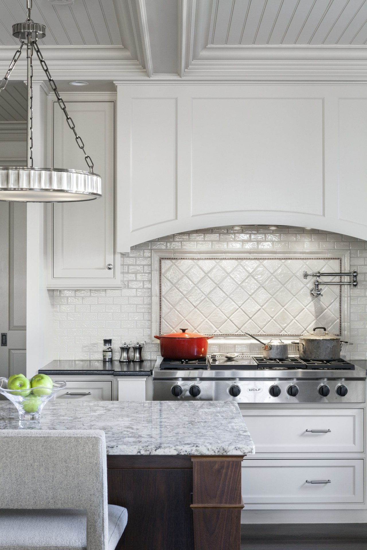 A backsplash panel in diagonally set raised pillow cabinetry, countertop, cuisine classique, floor, home, interior design, kitchen, room, window, gray
