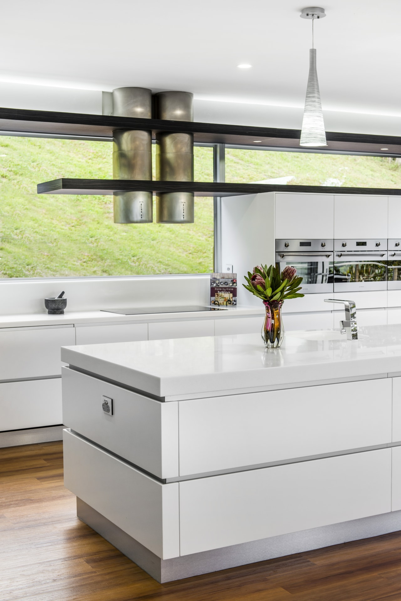 Sleek contemporary kitchen with Smeg appliances countertop, furniture, interior design, kitchen, product design, table, white