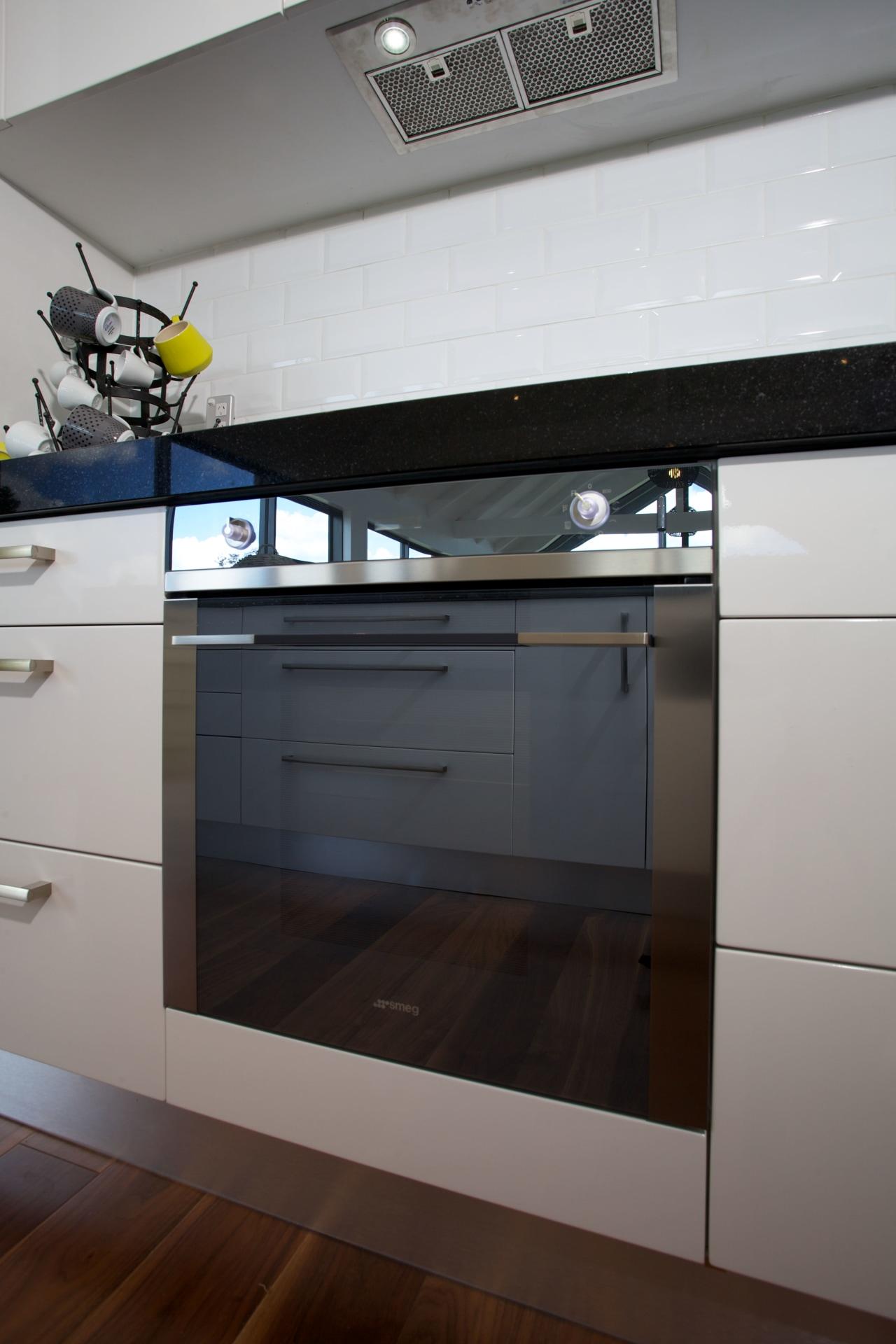 Contemporary kitchen with Smeg appliances countertop, home appliance, interior design, kitchen, kitchen stove, gray, black